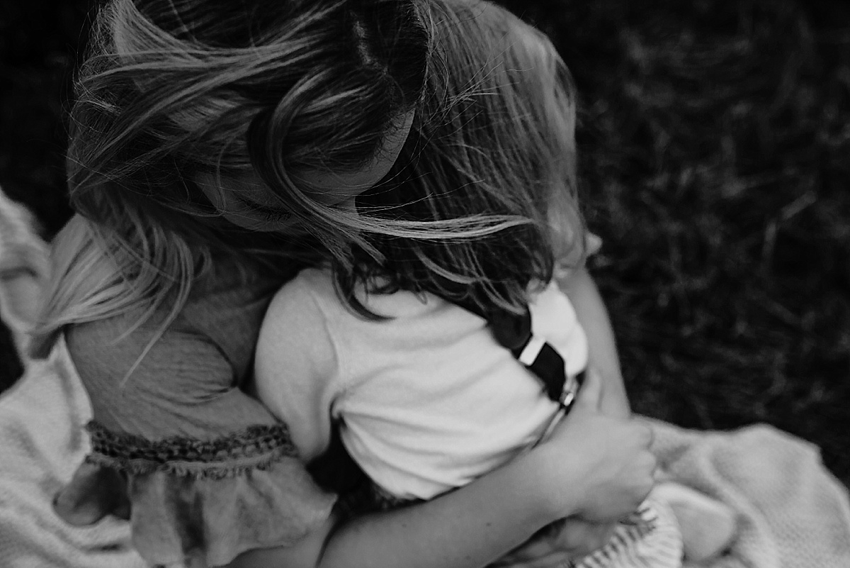 Looking down on mother embracing daughter