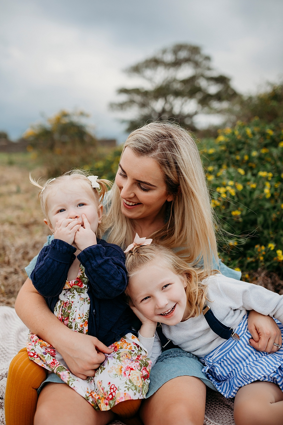 Mum laughing with two little girls