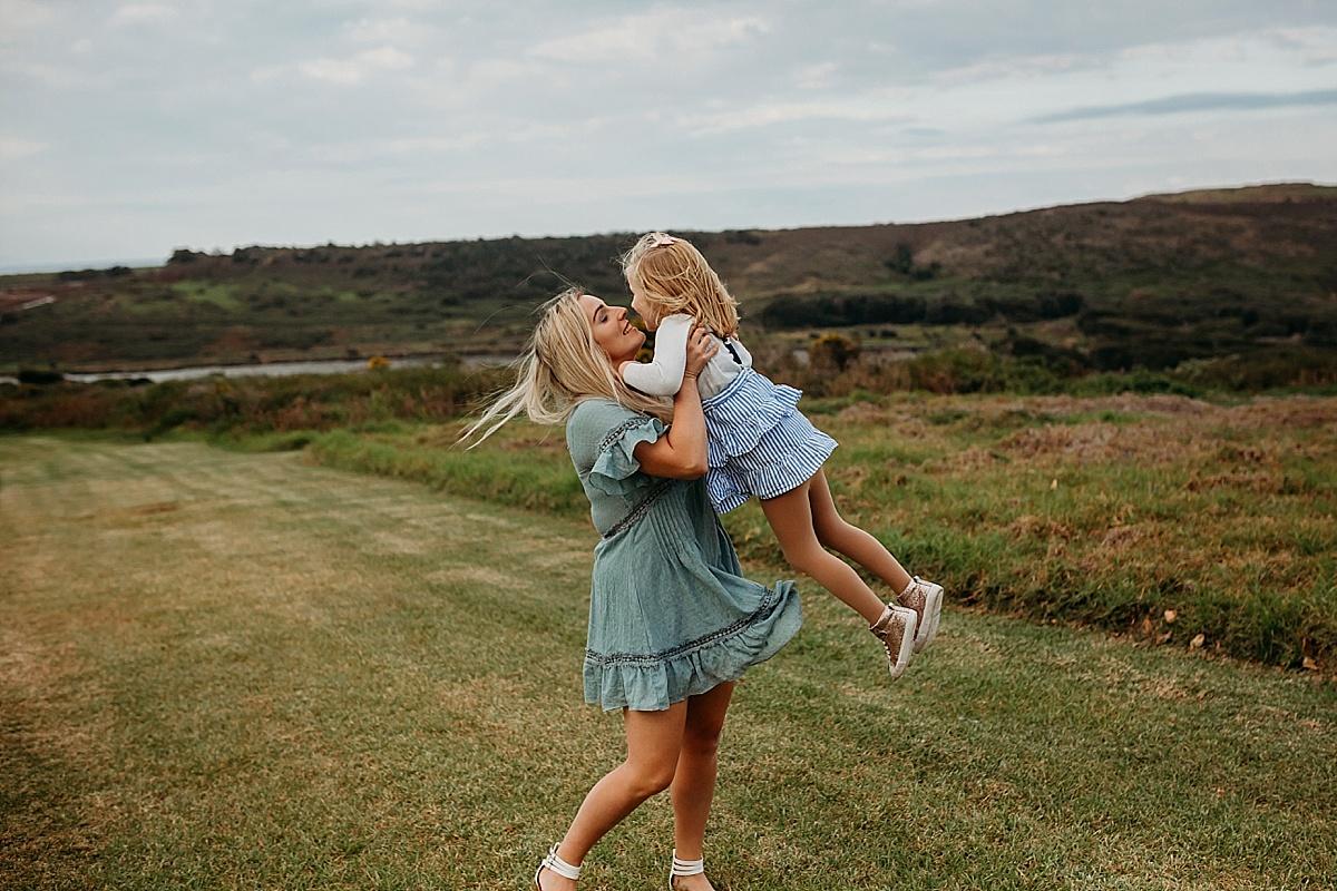 Mum picking up daughter spinning her