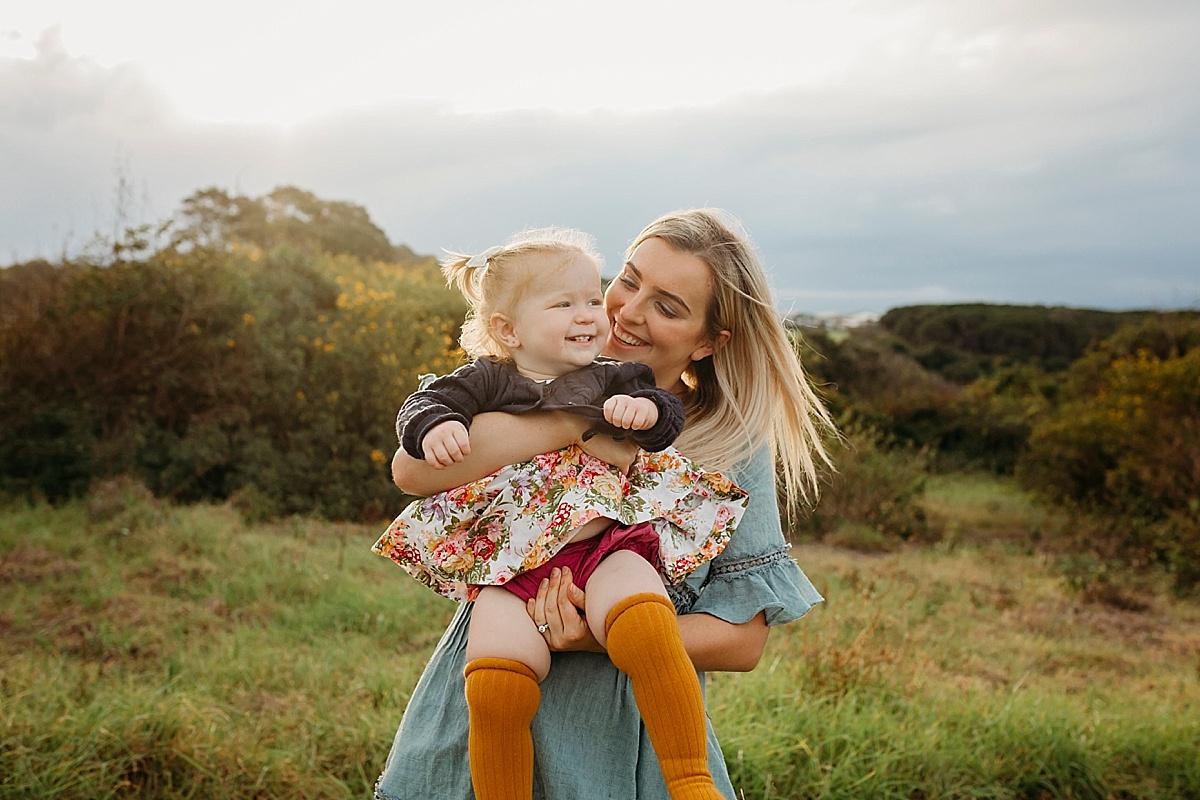 Mum holding her baby girl
