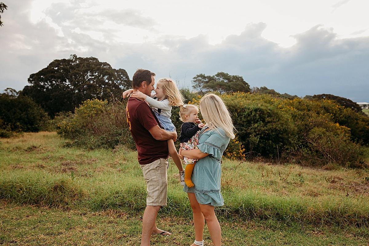 mum and dad holding kids