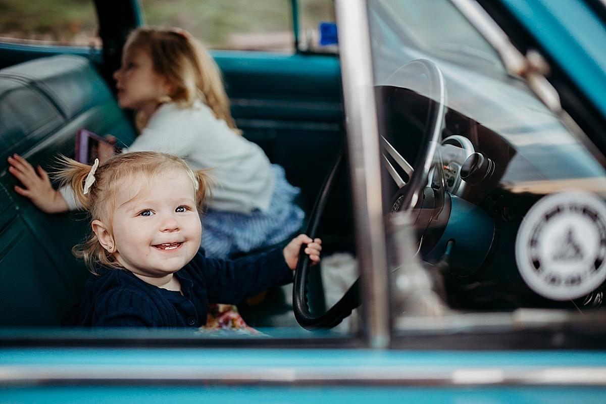 Baby girl pretending to drive