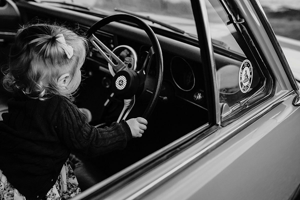 baby girl playing with steering wheel
