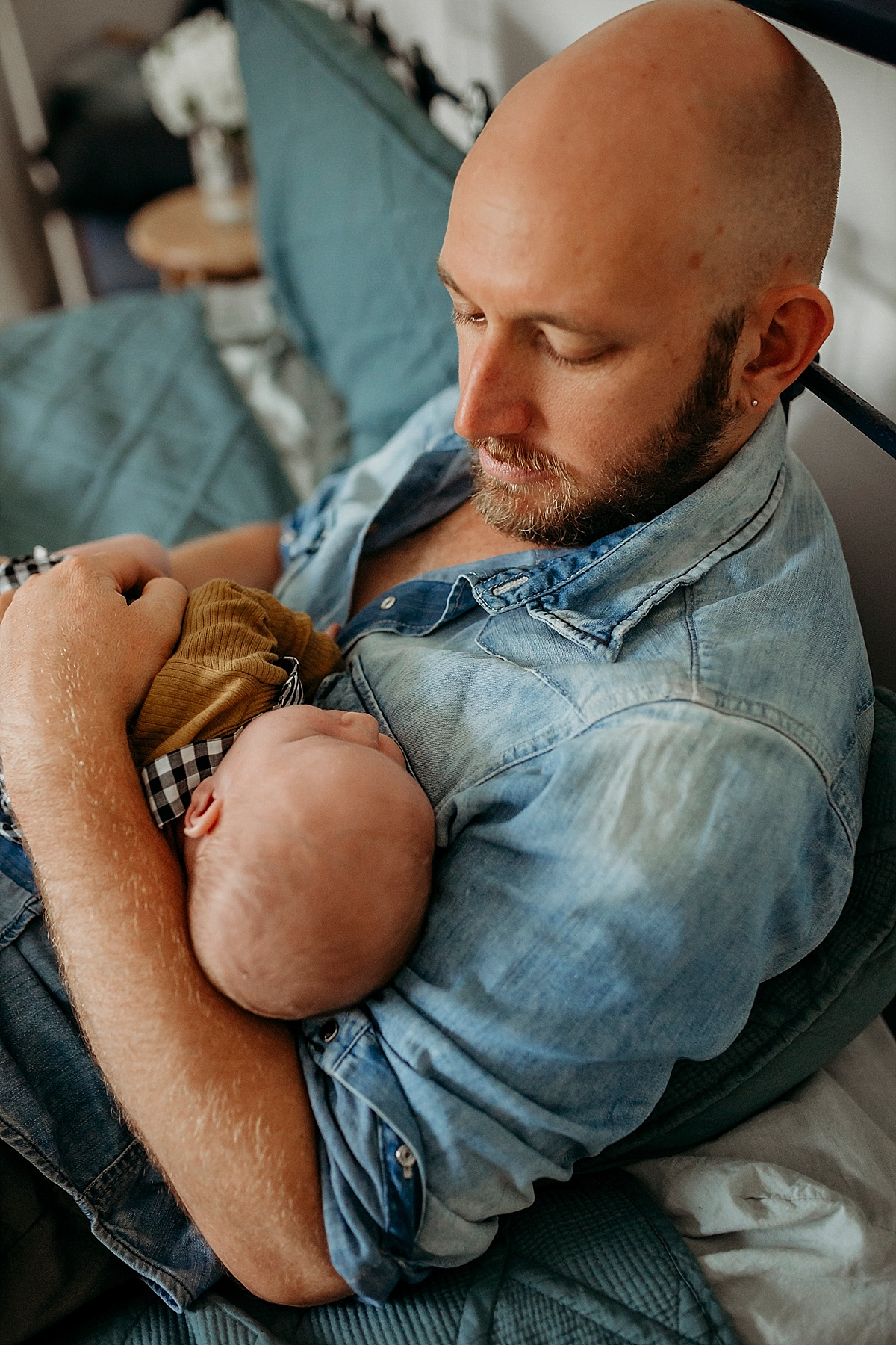 father holding new baby