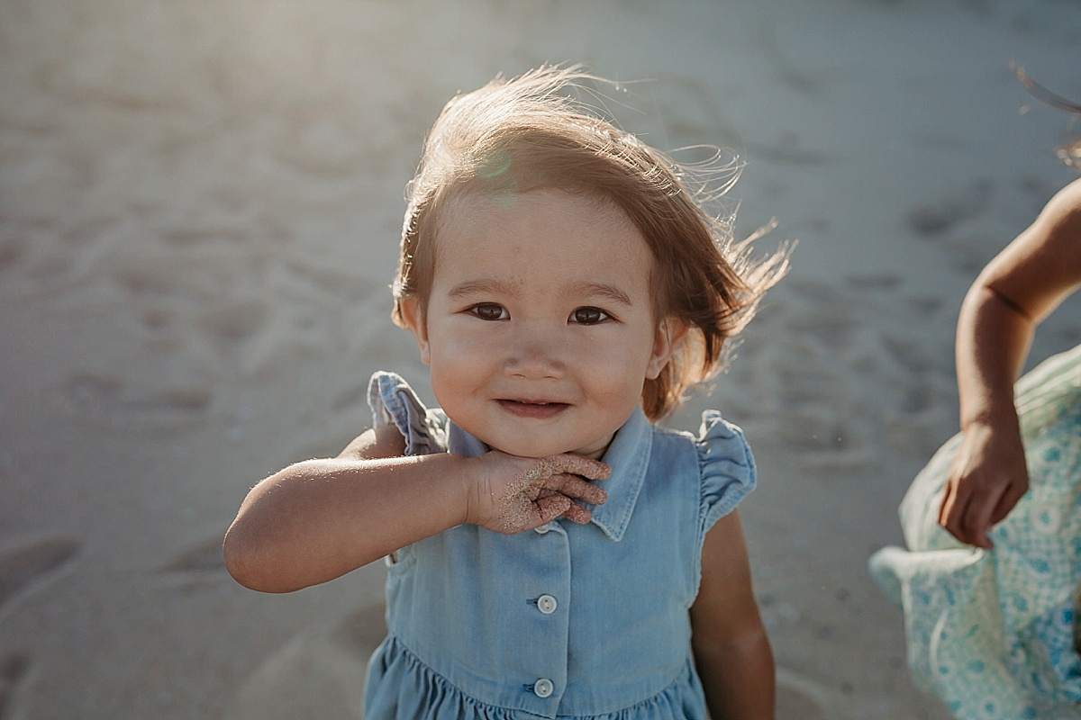 Little girl on beach at family photography session