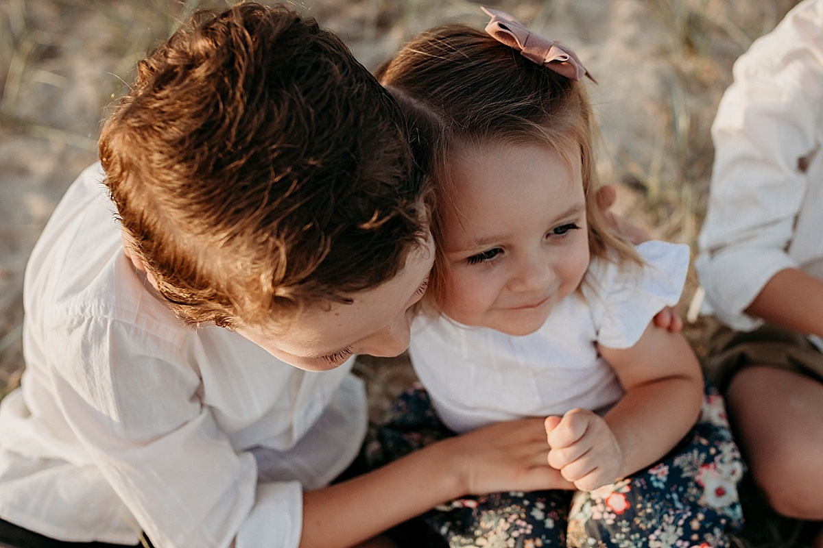 Brother giving little sister a cuddle at photo session
