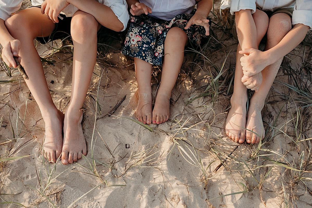 Three pairs of children's feet