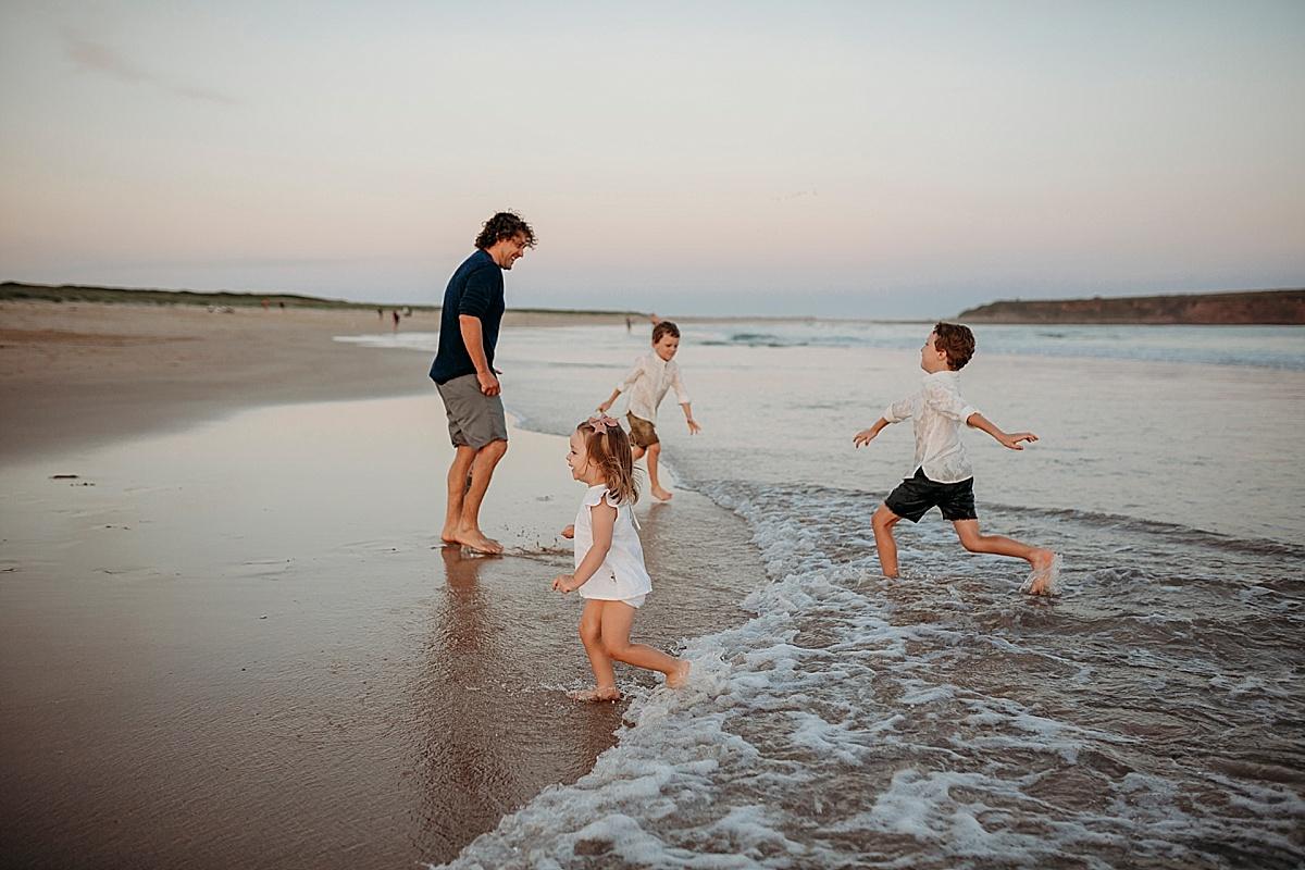 kicking water around at beach