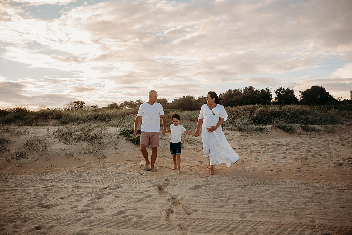 family of 3 at maternity session at port kembla beach