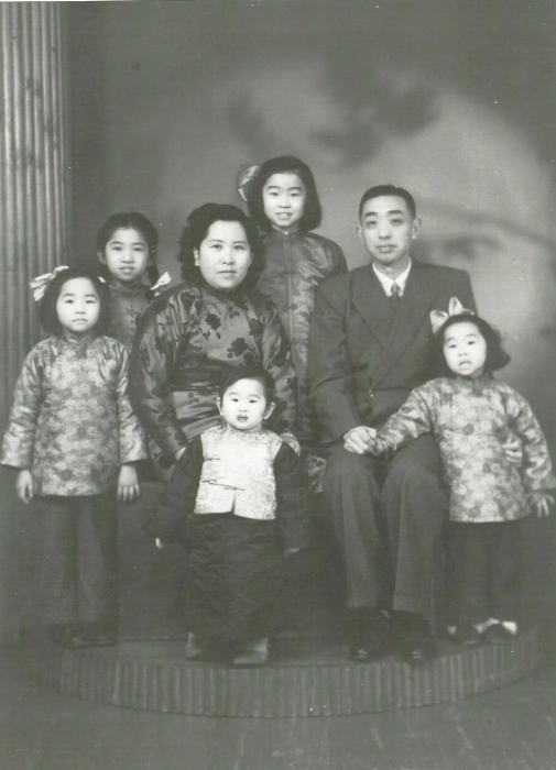 Madge family's Chinese New Year photo (the parents, 4 sisters, and the brother)