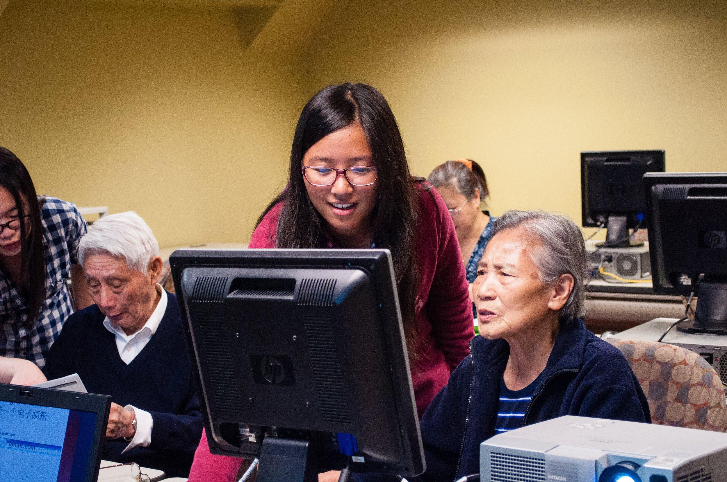 Iris teaching basic computer skills to elders in 2013.