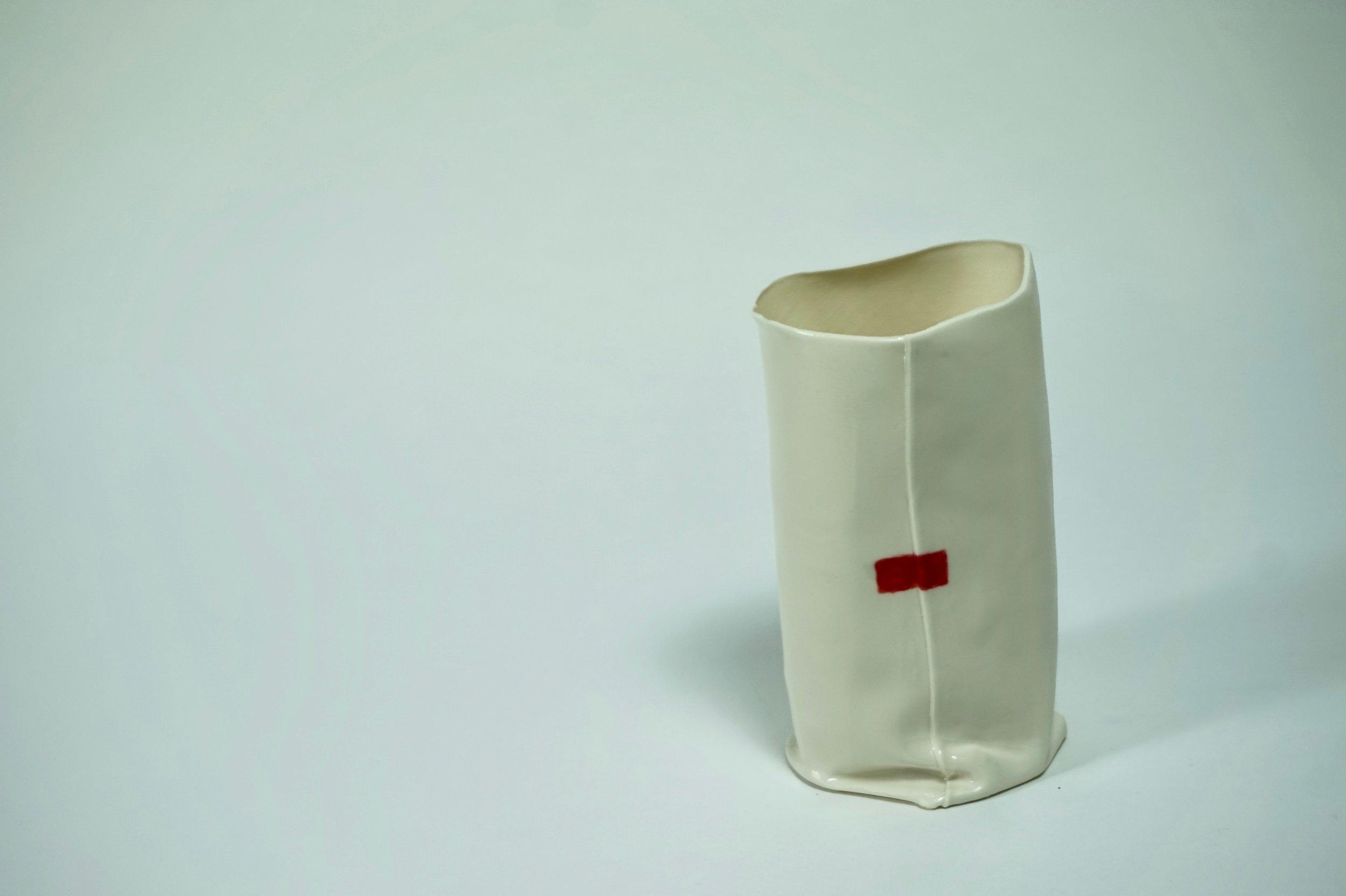 - Red tape on white body. Matt glaze