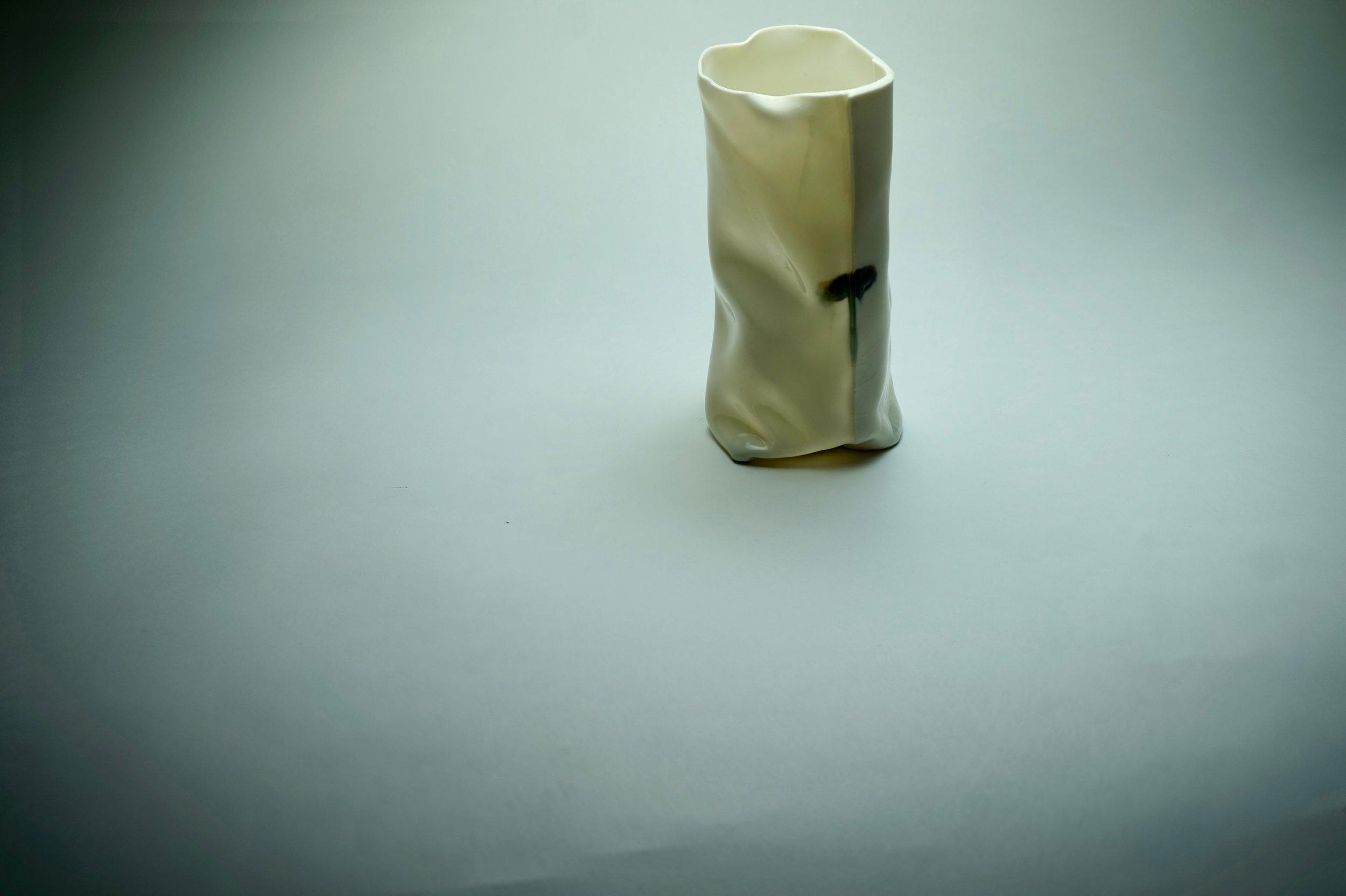 - Wrapped porcelain vessel under intense light