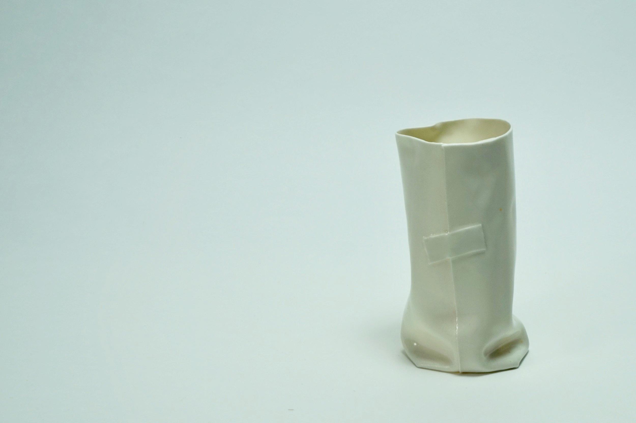 - White tape on white body. Gloss glaze