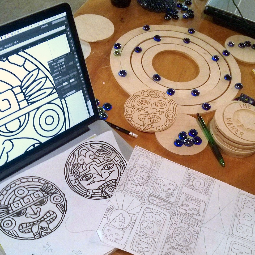 Fig. 4  I developed the designs of the 'God Piece' and backs of playing cards from sketches, then traced them in Adobe Illustrator. The vector drawing of the 'God Piece' was then fed to the CNC Router Program to create the final wooden version.