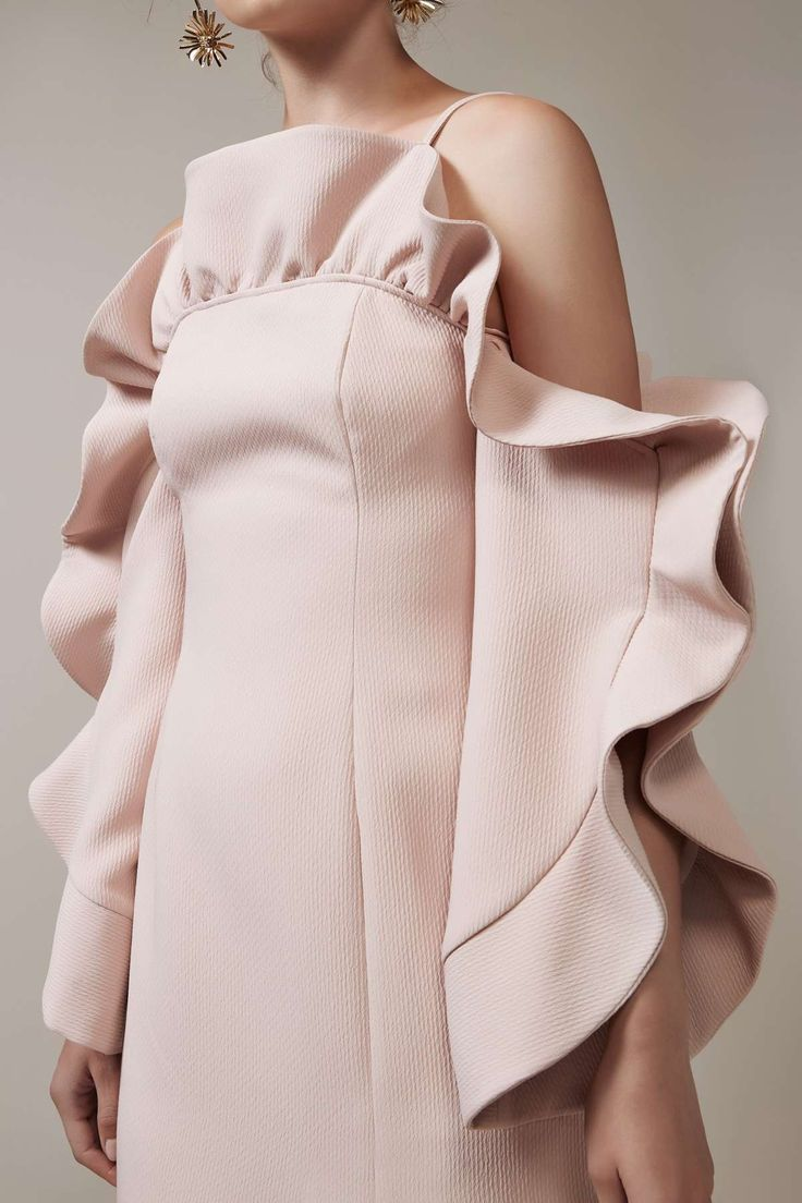 Bold ruffles in unexpected fabrics & shapes -