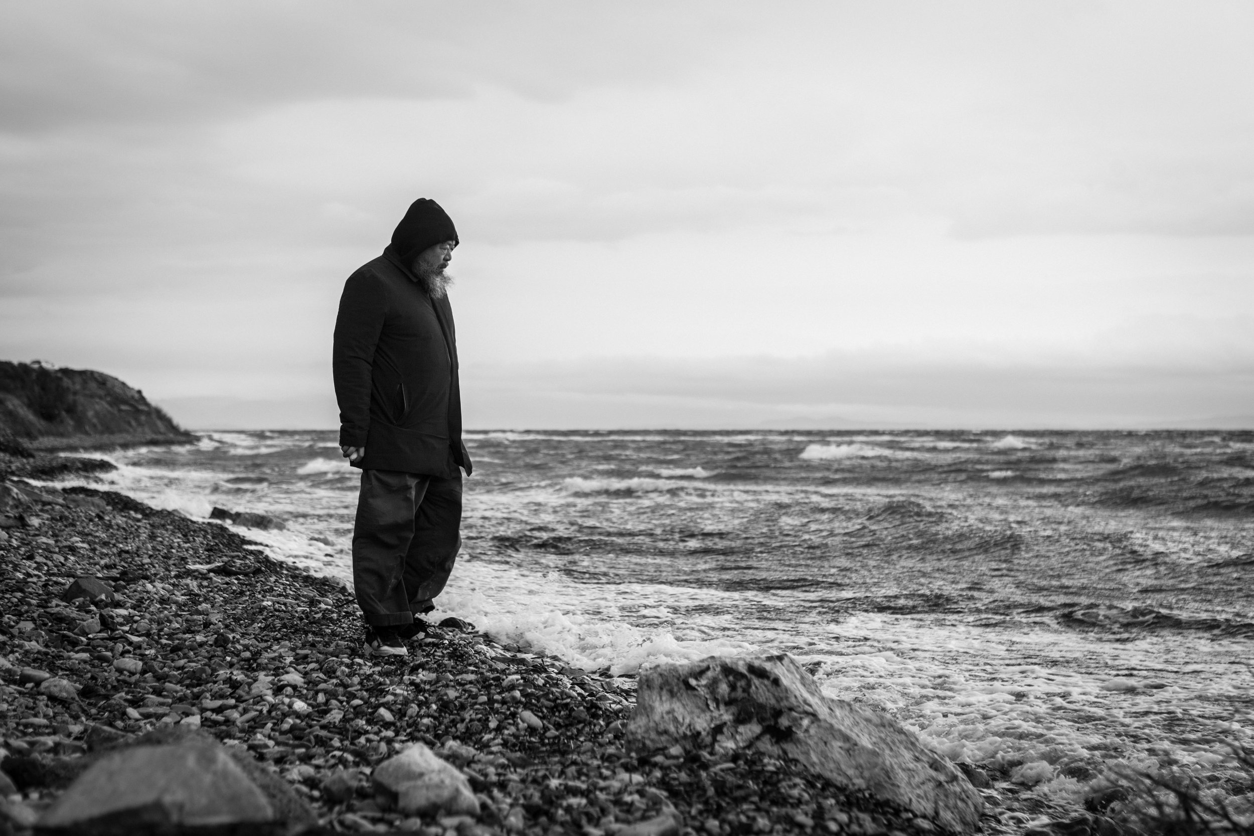 The artist on the coast of Lesvos, Greece, where refugees routinely float ashore