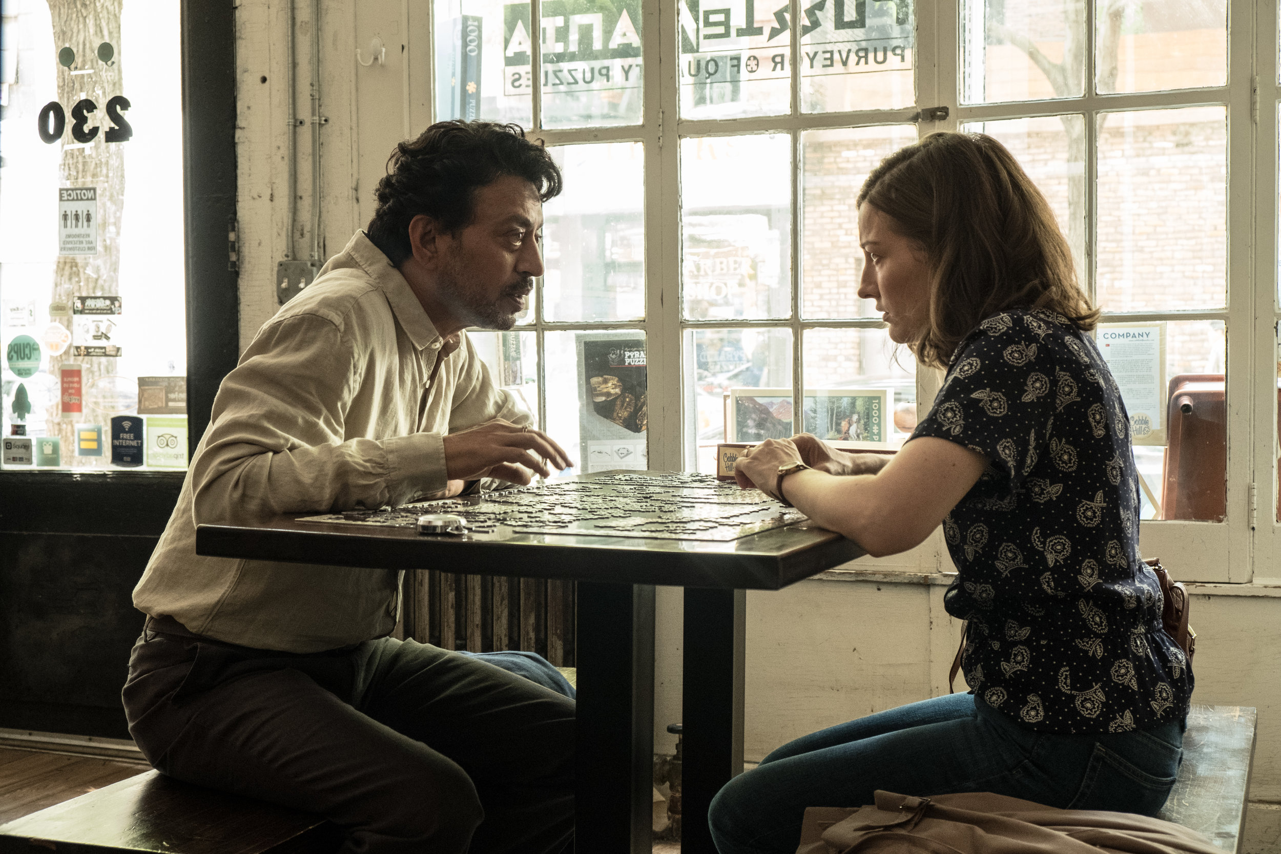 Irrfan Khan and housewife Kelly MacDonald try to figure out her gift for puzzle-solving in Puzzle