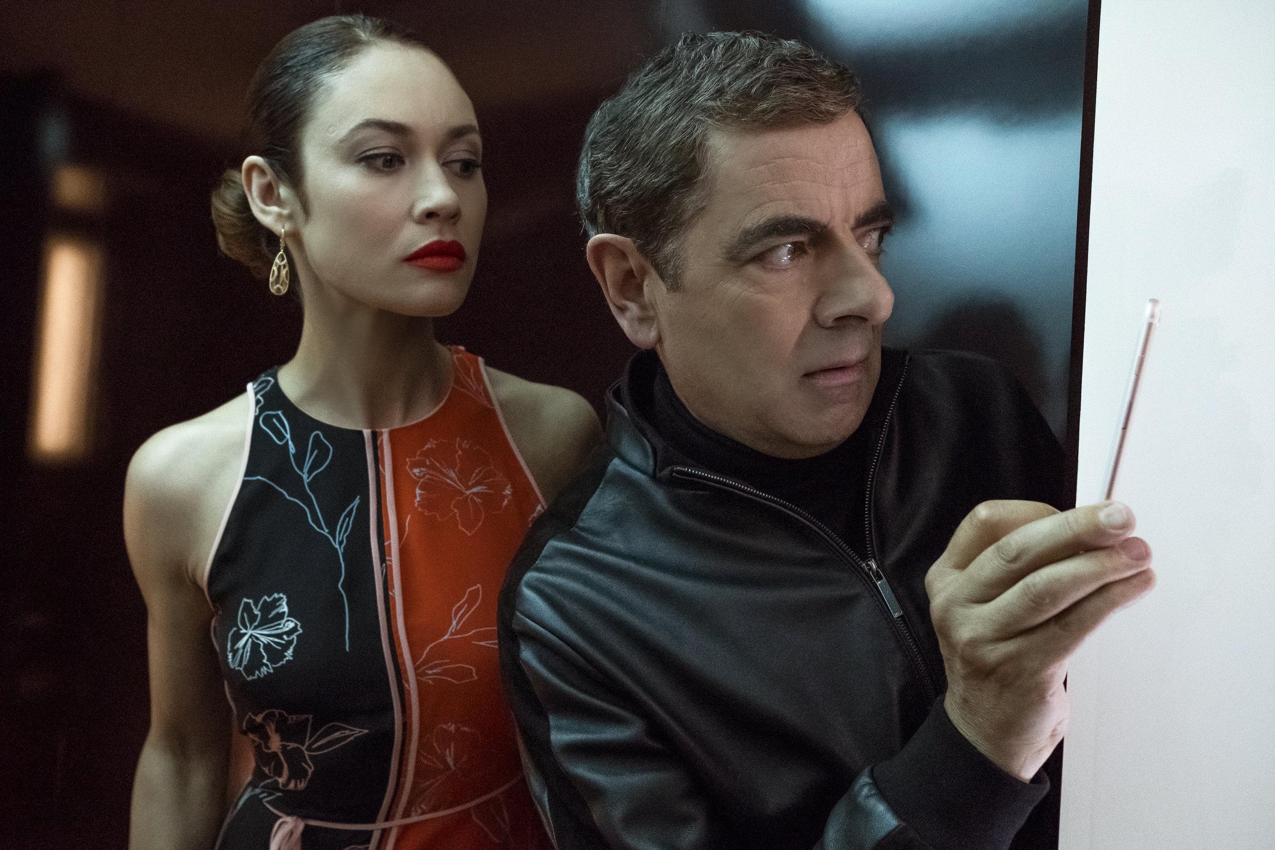 Kurylenko and Atkinson: A real Bond girl wonders what she's doing with a fake Bond.