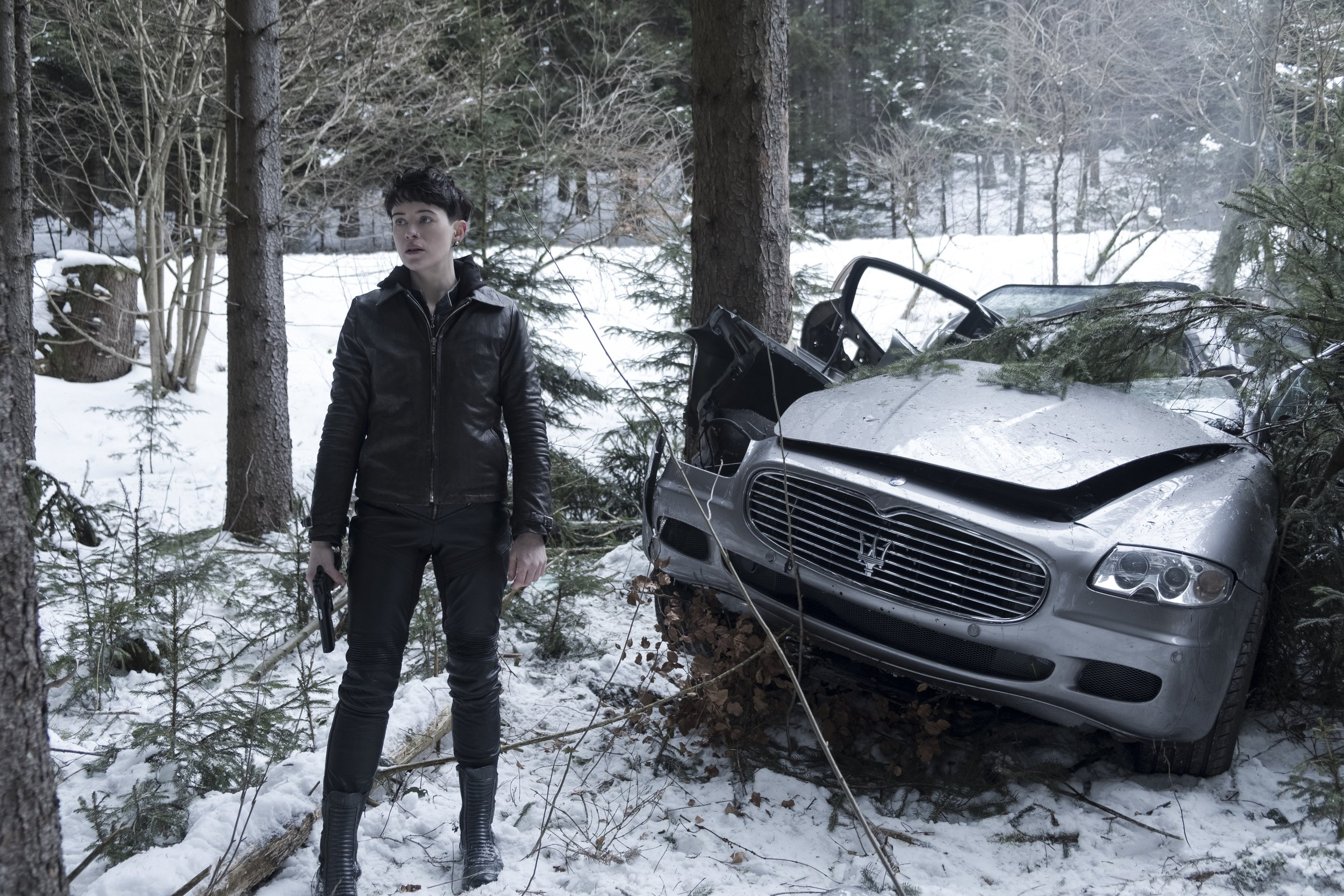 Haunted street kid no more: Lisbeth Salander (Claire Foy) kills cars and people with impunity.