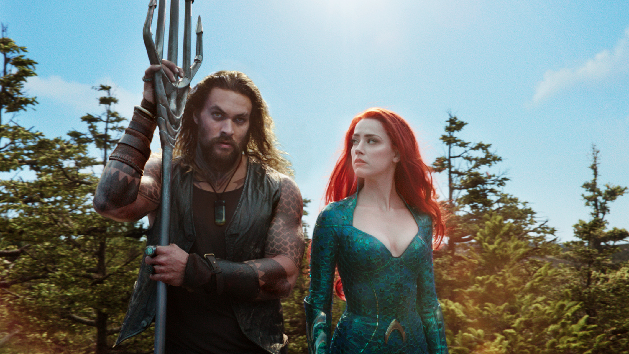 Jason Momoa and Amber Heard in Aquaman. Not all tridents are created equal.