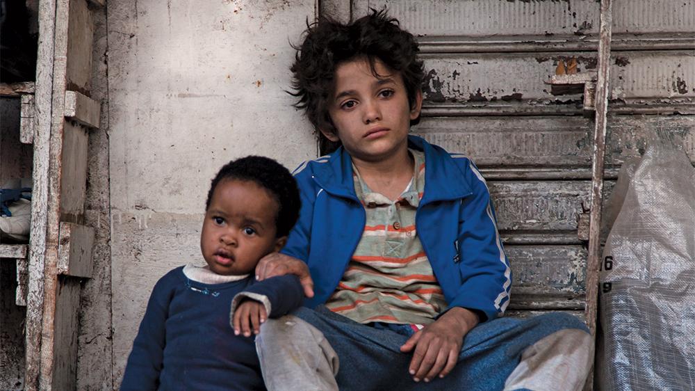 "Zain (Zain Al Rafeea) becomes a homeless ""guardian"" to Yonas (Boluwatife Treasure Bankole)"