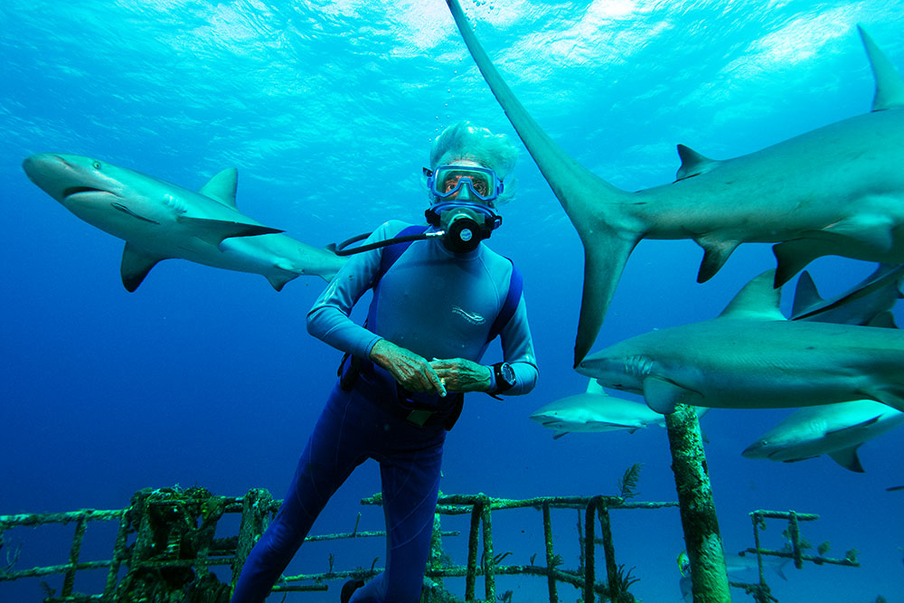 Jean-Michel Cousteau poses with finny friends in Wonders of the Sea 3D