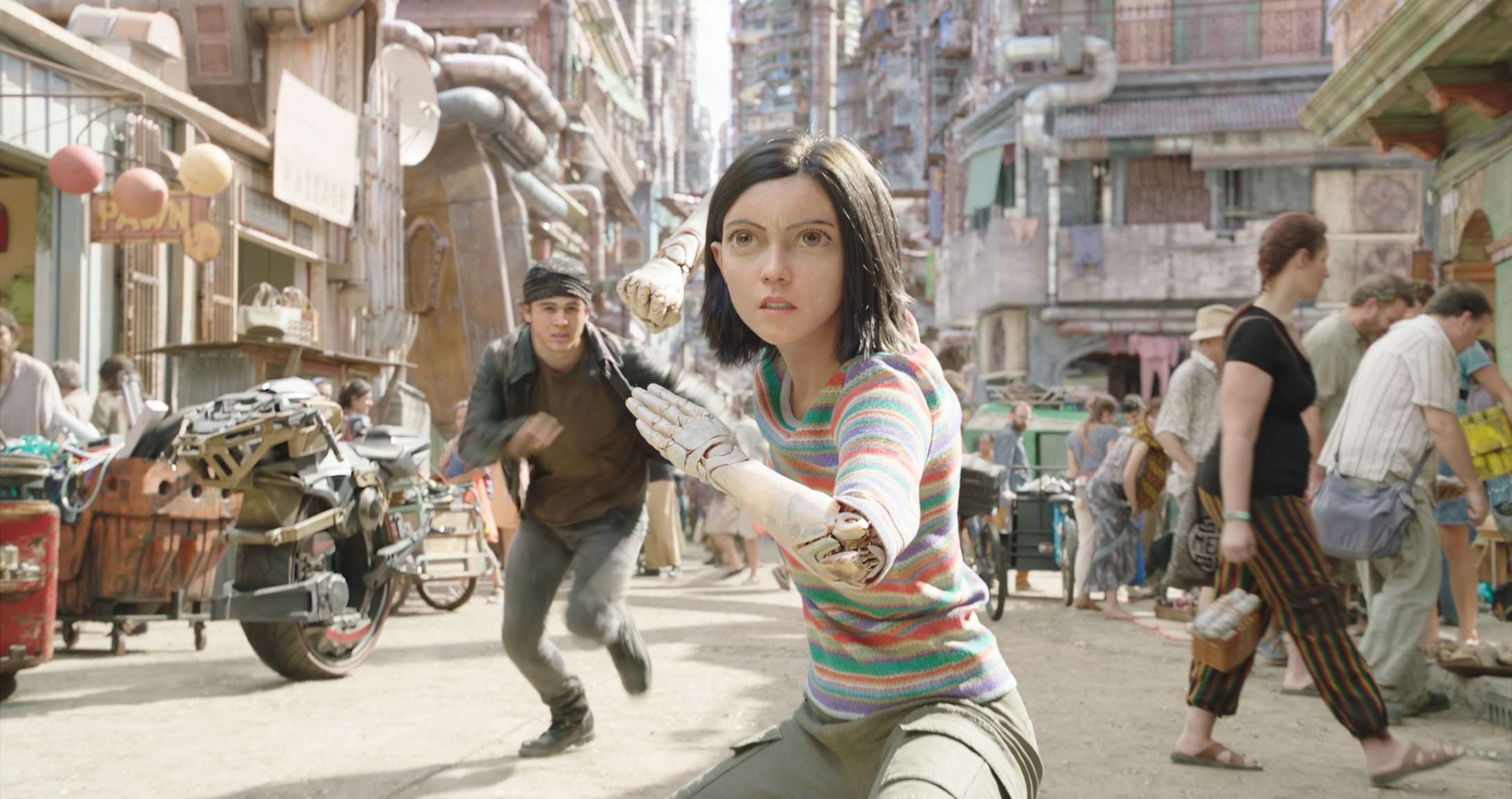 Keean Johnson and a cyborg-iced Rosa Salazar fight their way through Iron City in Alita: Battle Angel.