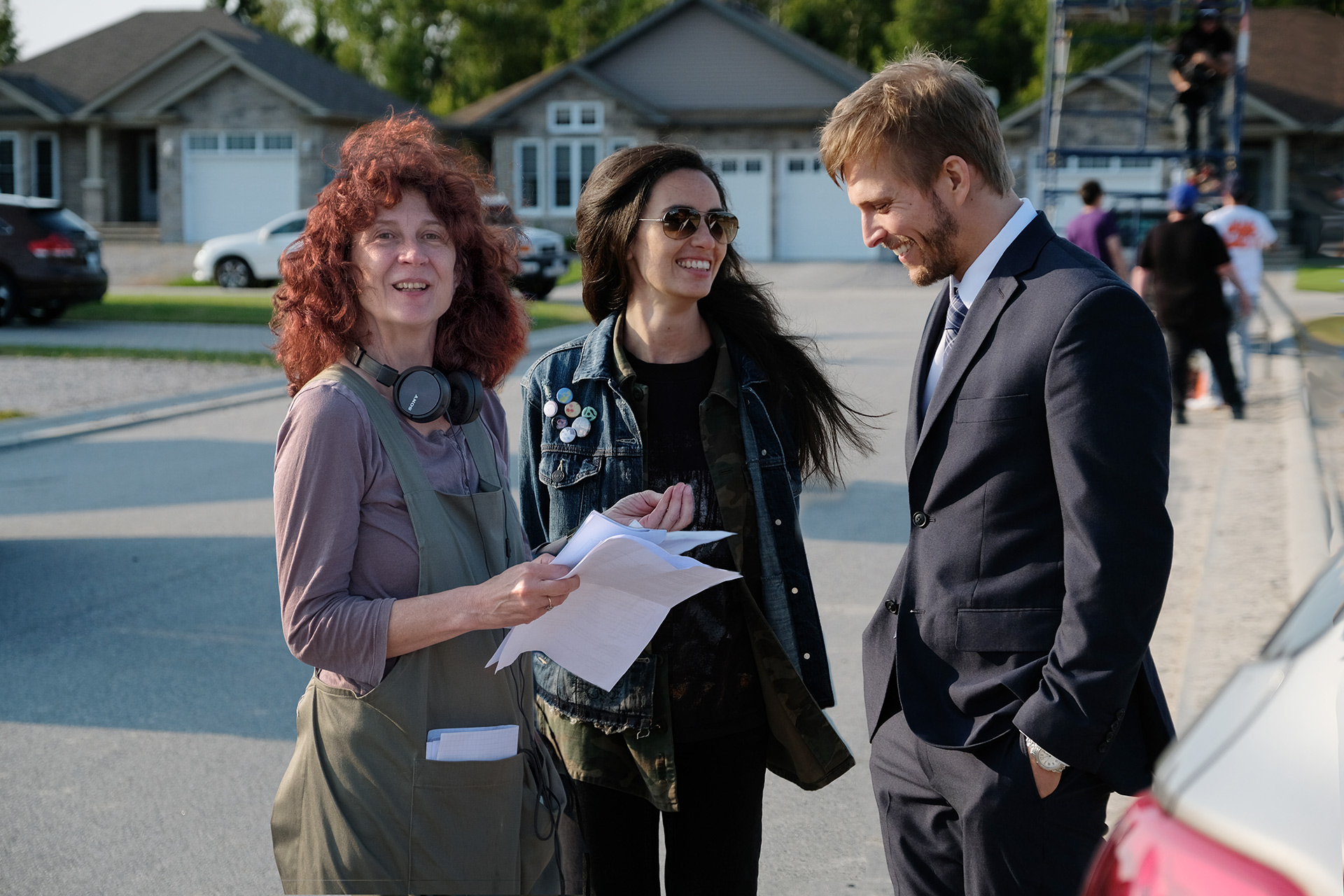 Director Roz Owen and cast members Cara Gee and Jon Cor on the set of Trouble in the Garden