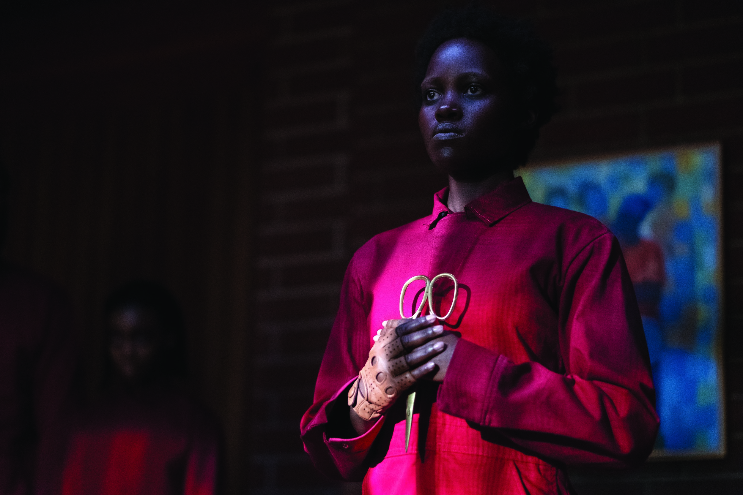Lupita Nyong'o playing her bad self in Jordan Peele's Us.