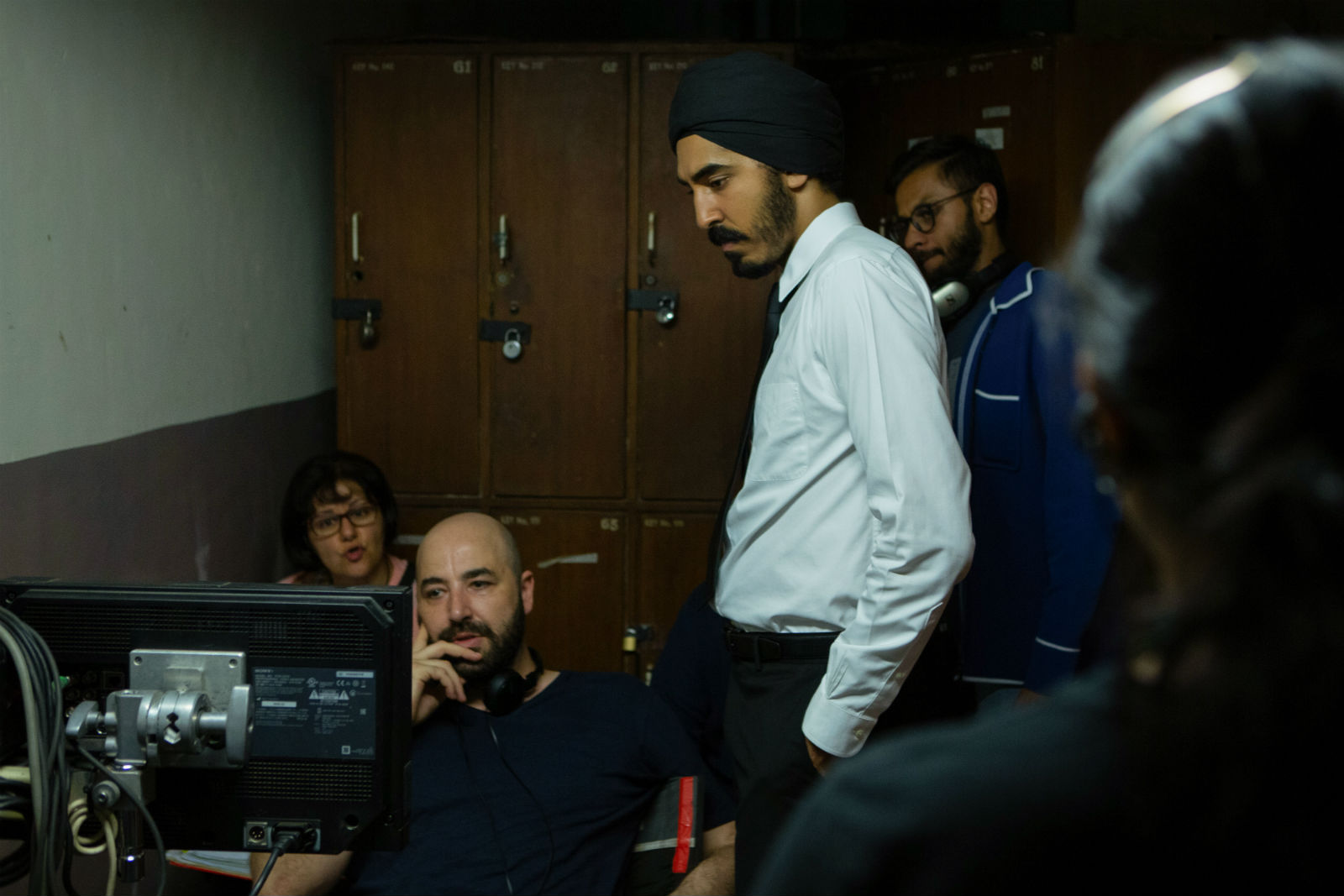 Director Anthony Maras (left) and actor Dev Patel (right) on the set of Hotel Mumbai.