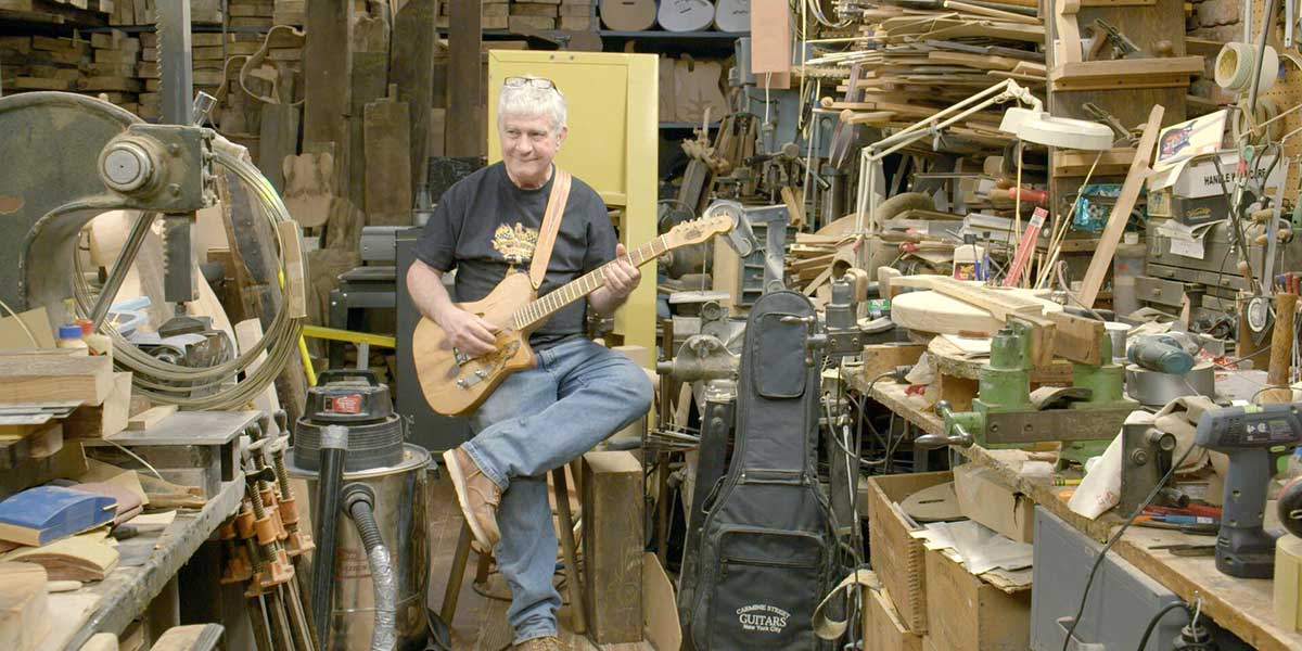 Guitar re-constructionist Rick Kelly, and his cluttered workshop in the doc Carmine Street Guitars