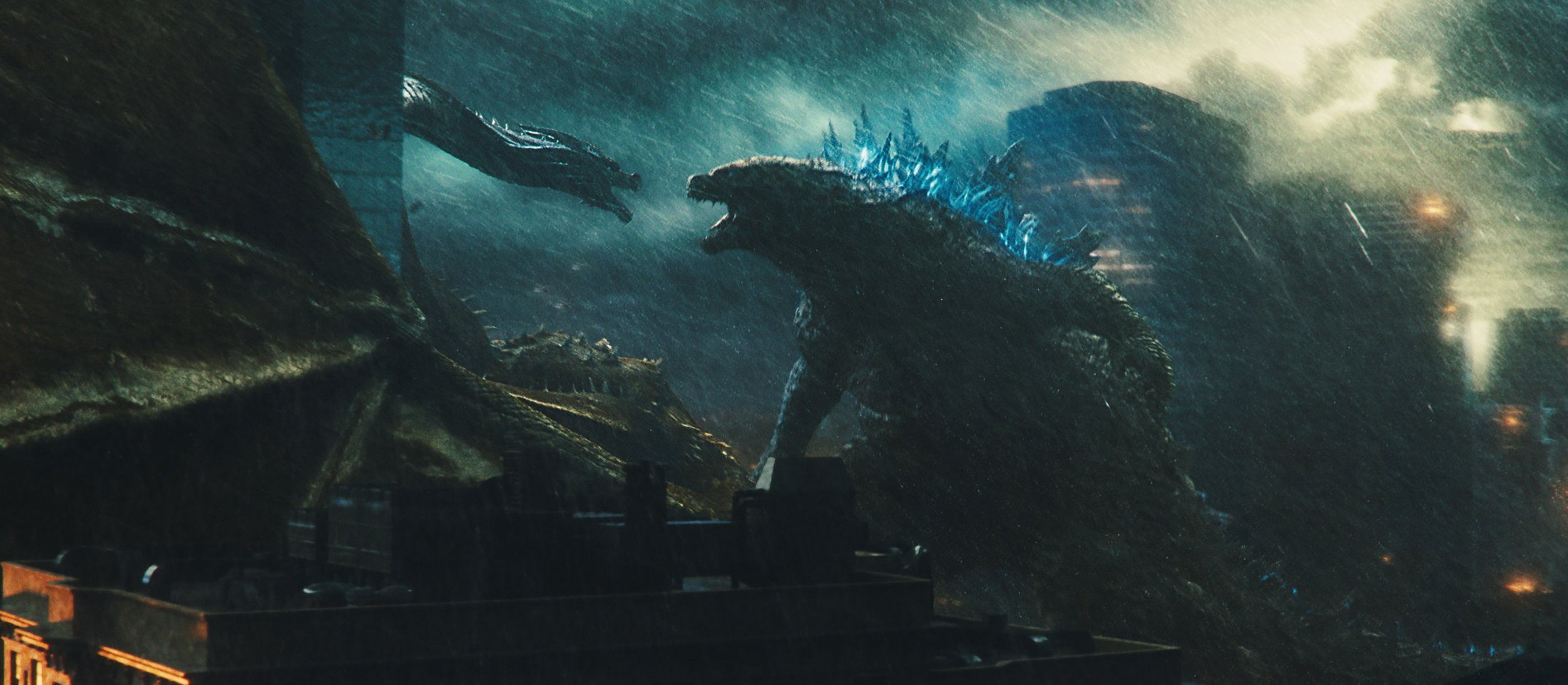 Godzilla and King Ghidorah dance in the dark for the Throne of the Titans.