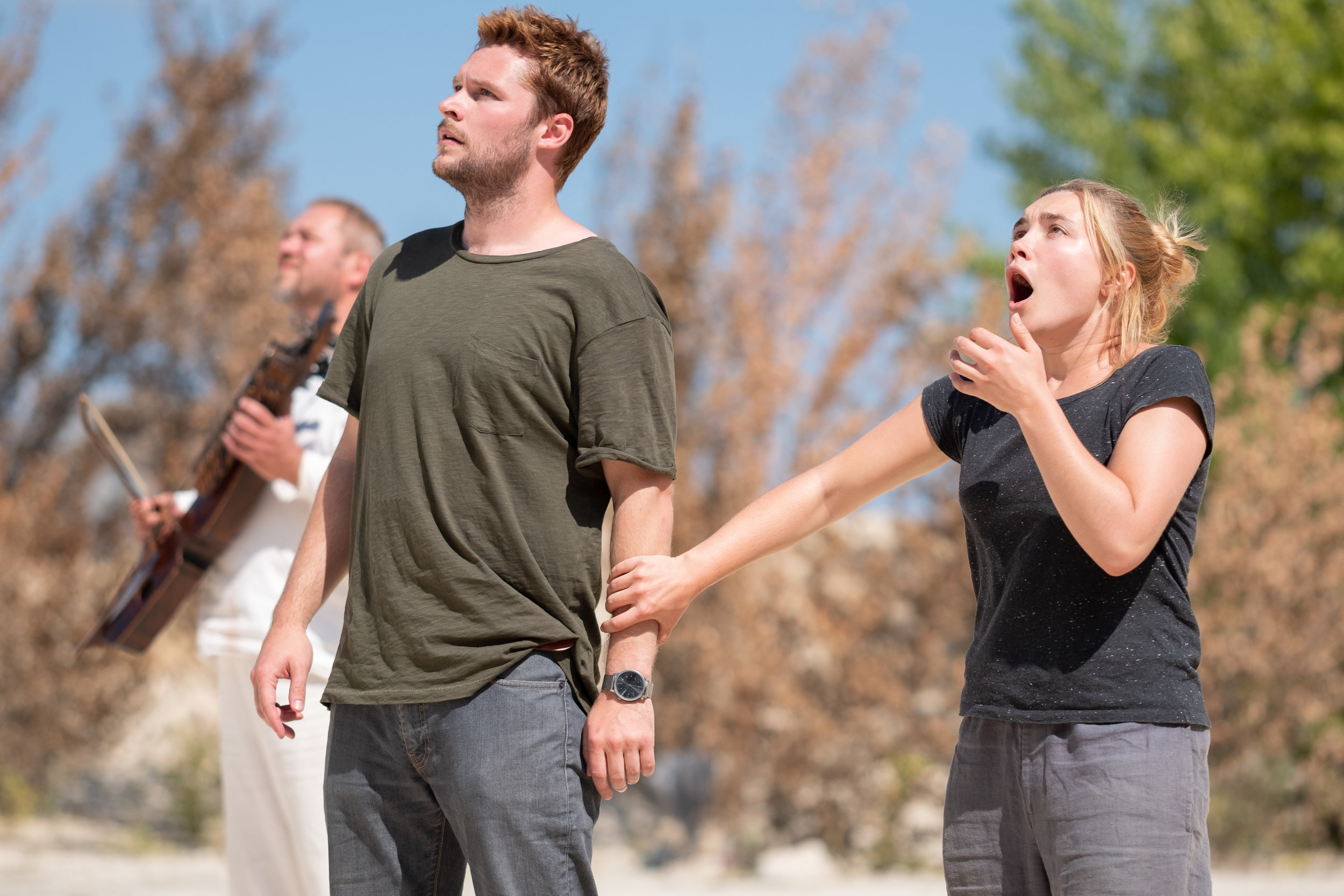 In Midsommar, Jack Reynor and Florence Pugh can't believe what's happening in a Swedish pagan commune