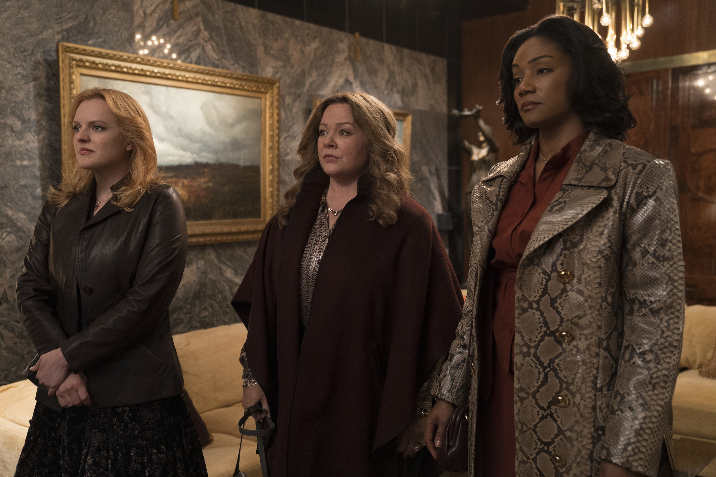 Elizabeth Moss, Melissa McCarthy and Tiffany Haddish learn to play the mob protection game