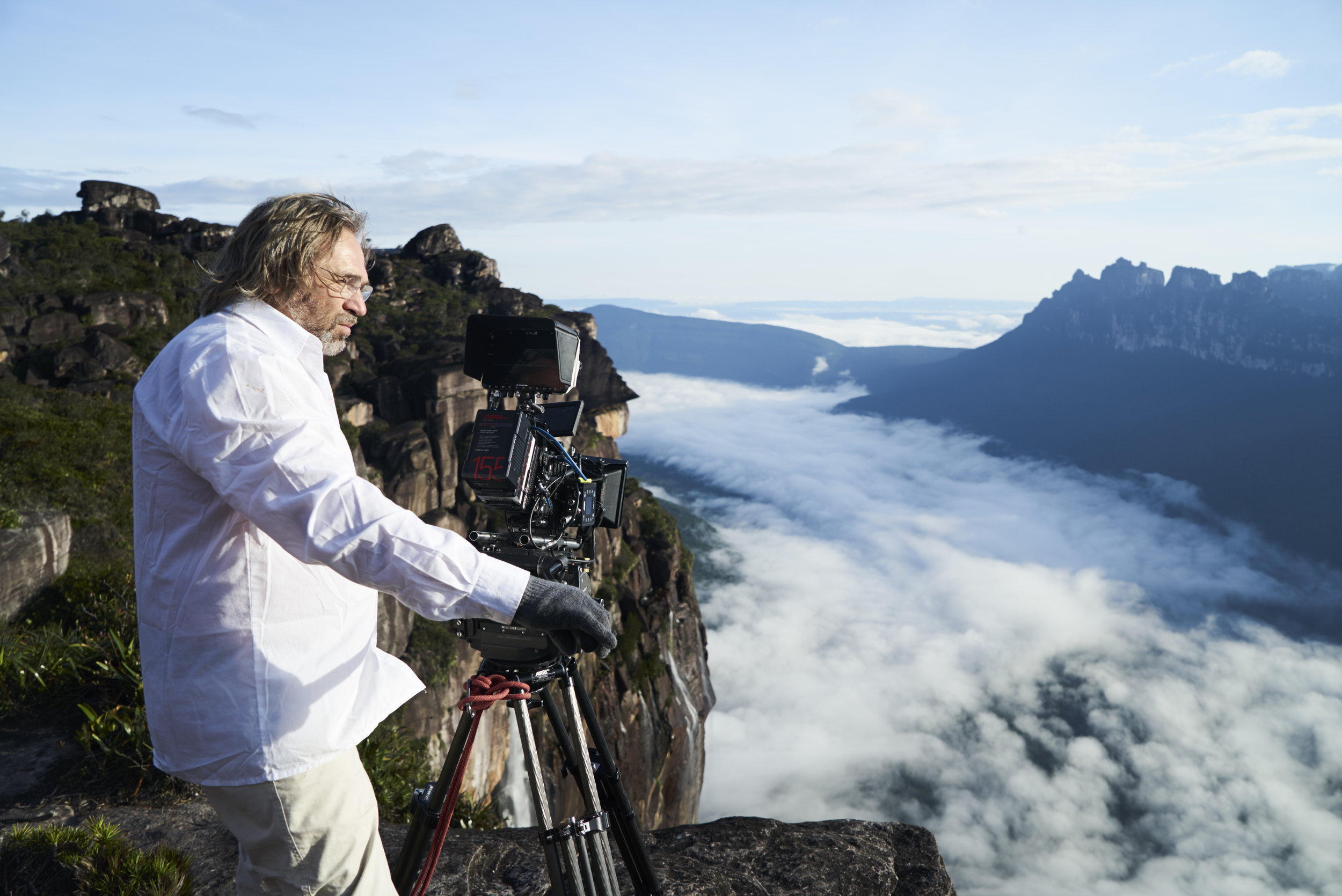 Director Viktor Kossakovsky sets up a shot perilously close to Angel Falls in the documentary Aquarela