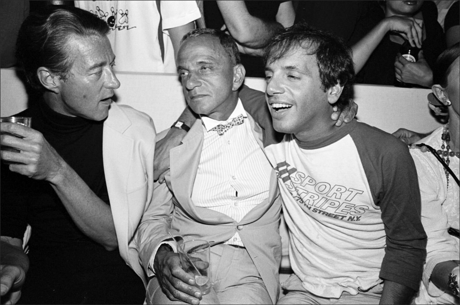 Halston (left to right), Roy Cohn, Steve Rubell getting drunk, making nice.