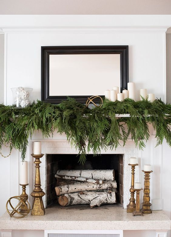 Step two: put a garland on it.  Garland is your bestfriend when it comes to the holiday season. Mantle? Done. Tree? Done. Tablespace? Done. Creative gift wrapping? Done. The list goes on. (pst, stay tuned for some more gift wrapping ideas to come).   //source