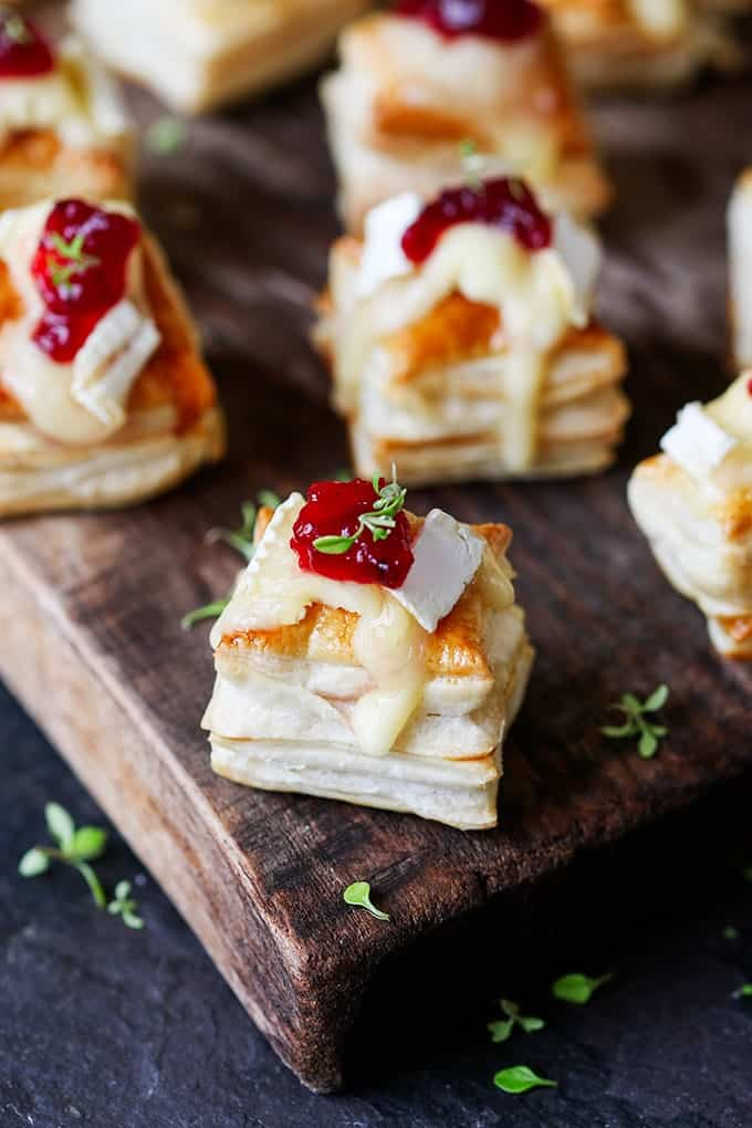 Brie Bites: What is a party without cheese? These cranberry and brie bites are so easy to make. No really, 20 minutes. That's it.   //recipe
