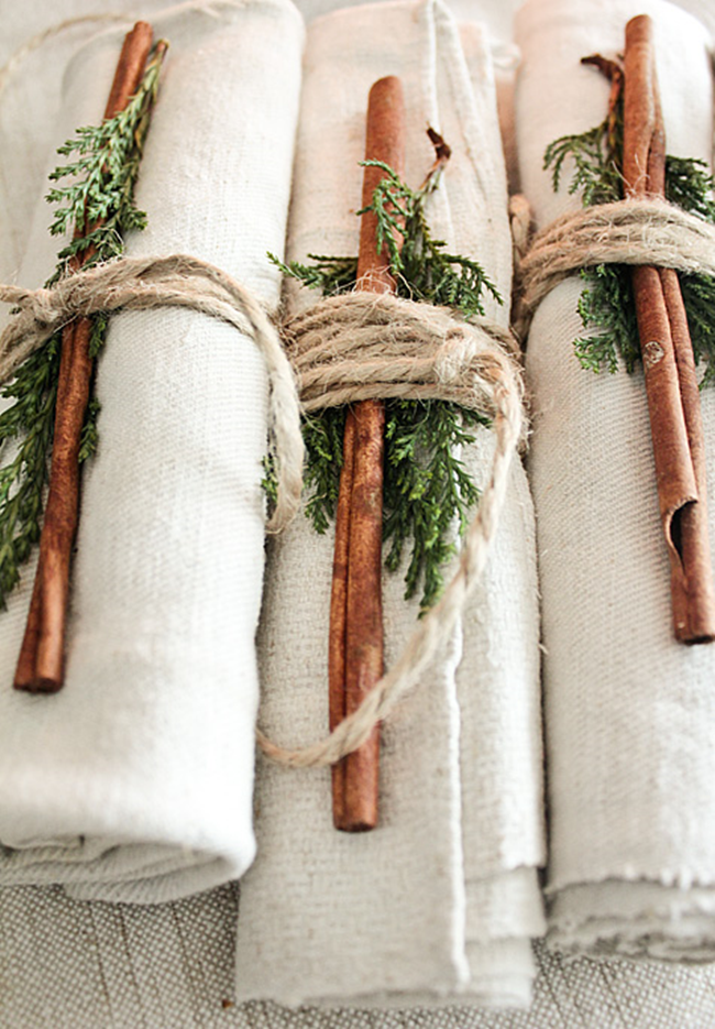 Adding a little pop to your napkin rollup is another cheap, easy way to make your tablescape one to remember. Think a sprig of thyme or stick of cinnamon, it can't get easier than that people!   //source