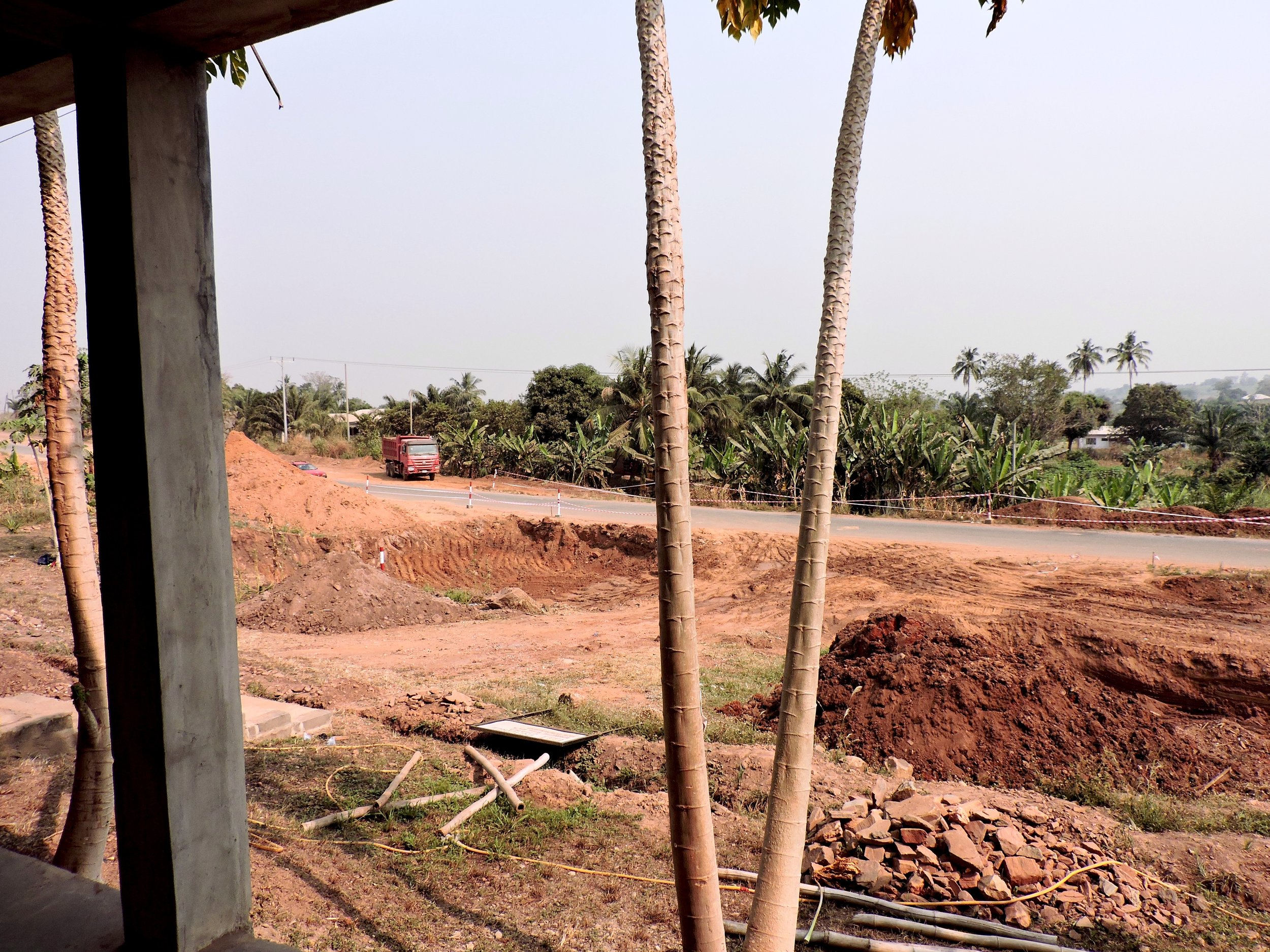 A view of the two holes dug for the road expansion in front of the VEG compound