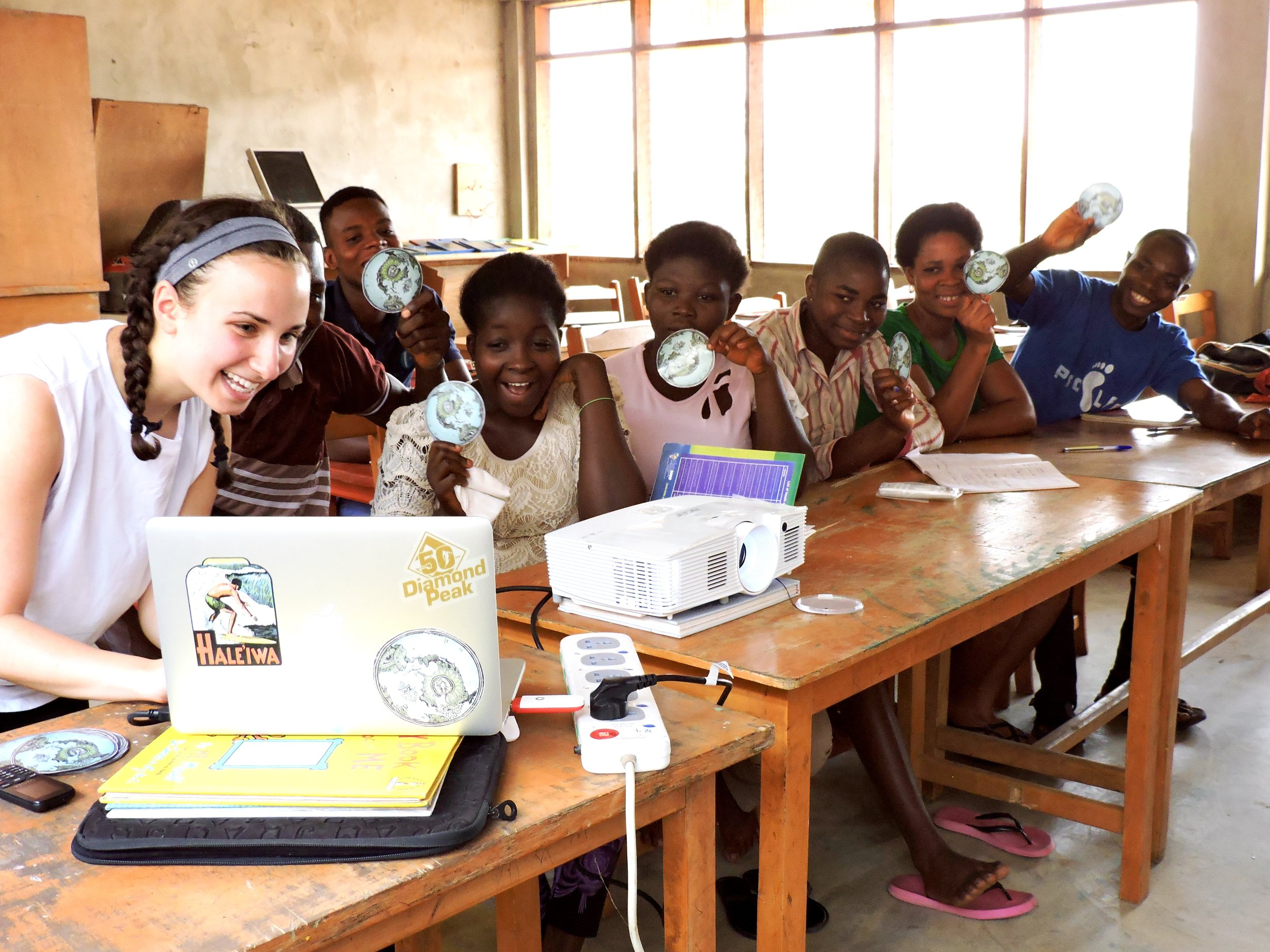 Trying to get everyone in the computer screen-showing our R.O.C. stickers here in Ghana as SB students show theirs in VT