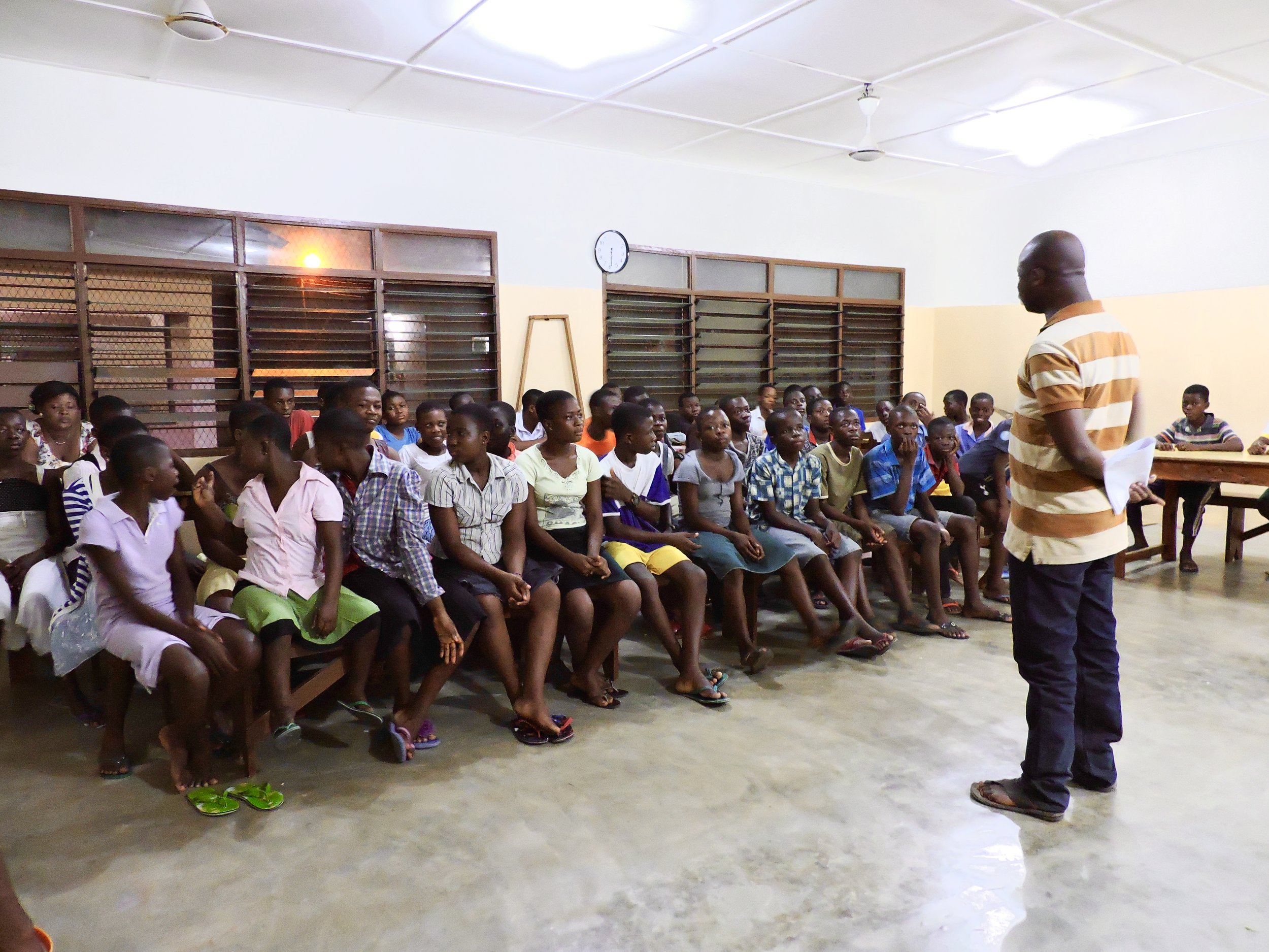 It was hard to get a picture of everyone sitting still! But here is Kofi doing introductions infront of the class at Madam Fo Ghana