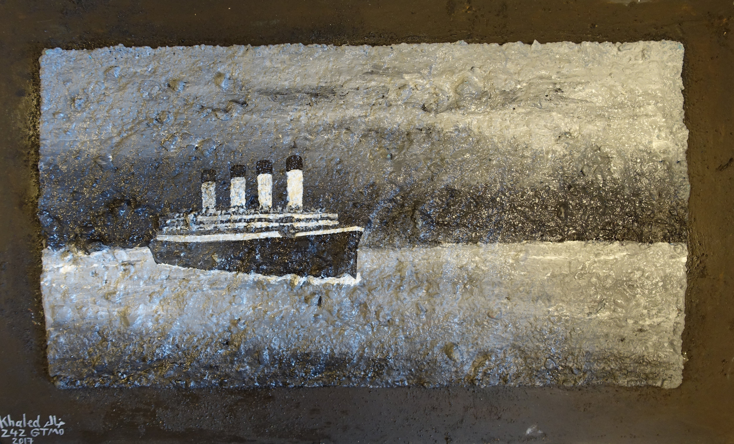 Khalid Qasim, Titanic in Black and White, 2017, paint over gravel mixed with glue.