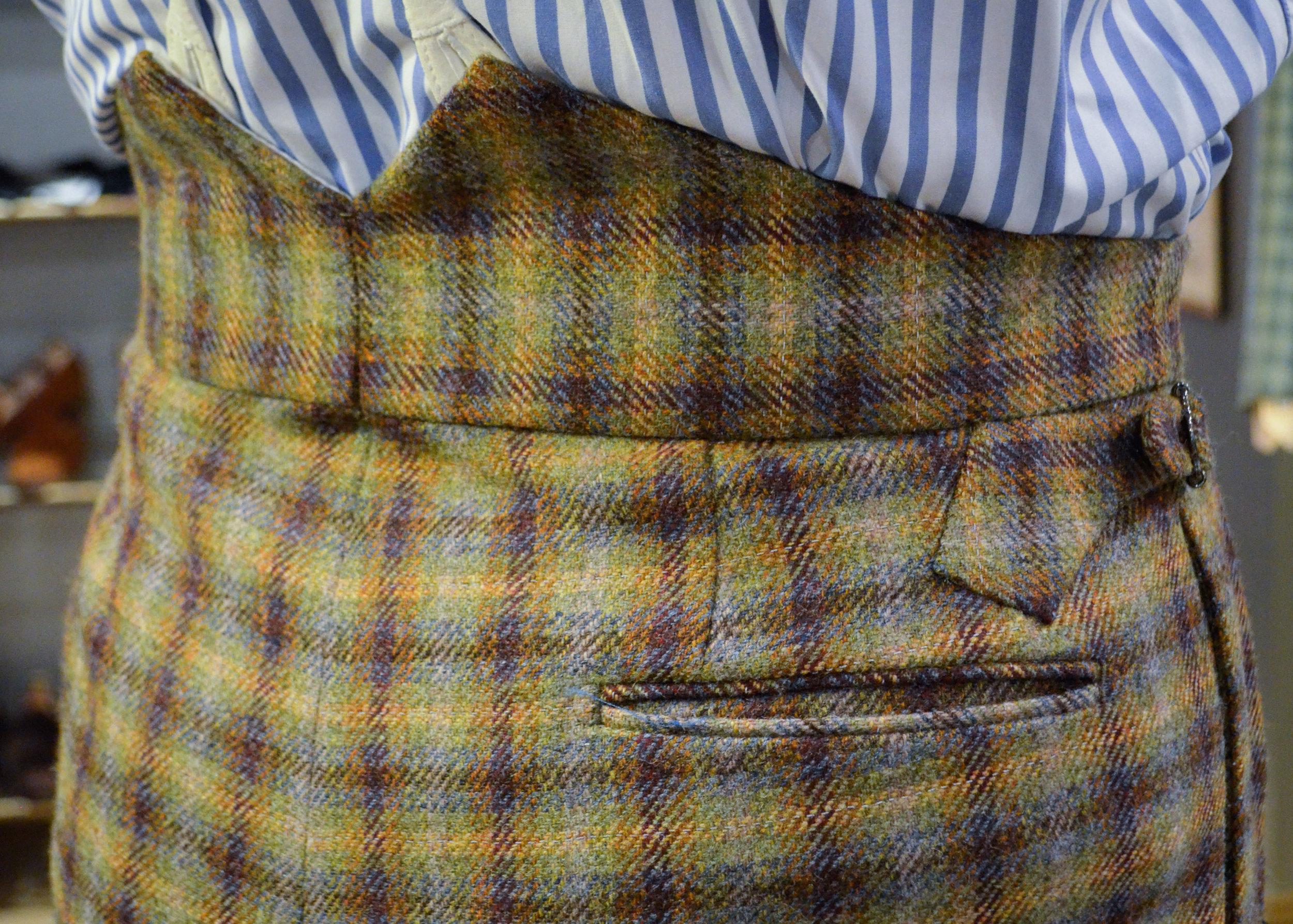 Left: Fishtail back waistband / Right: Bi-swing half-belted jacket