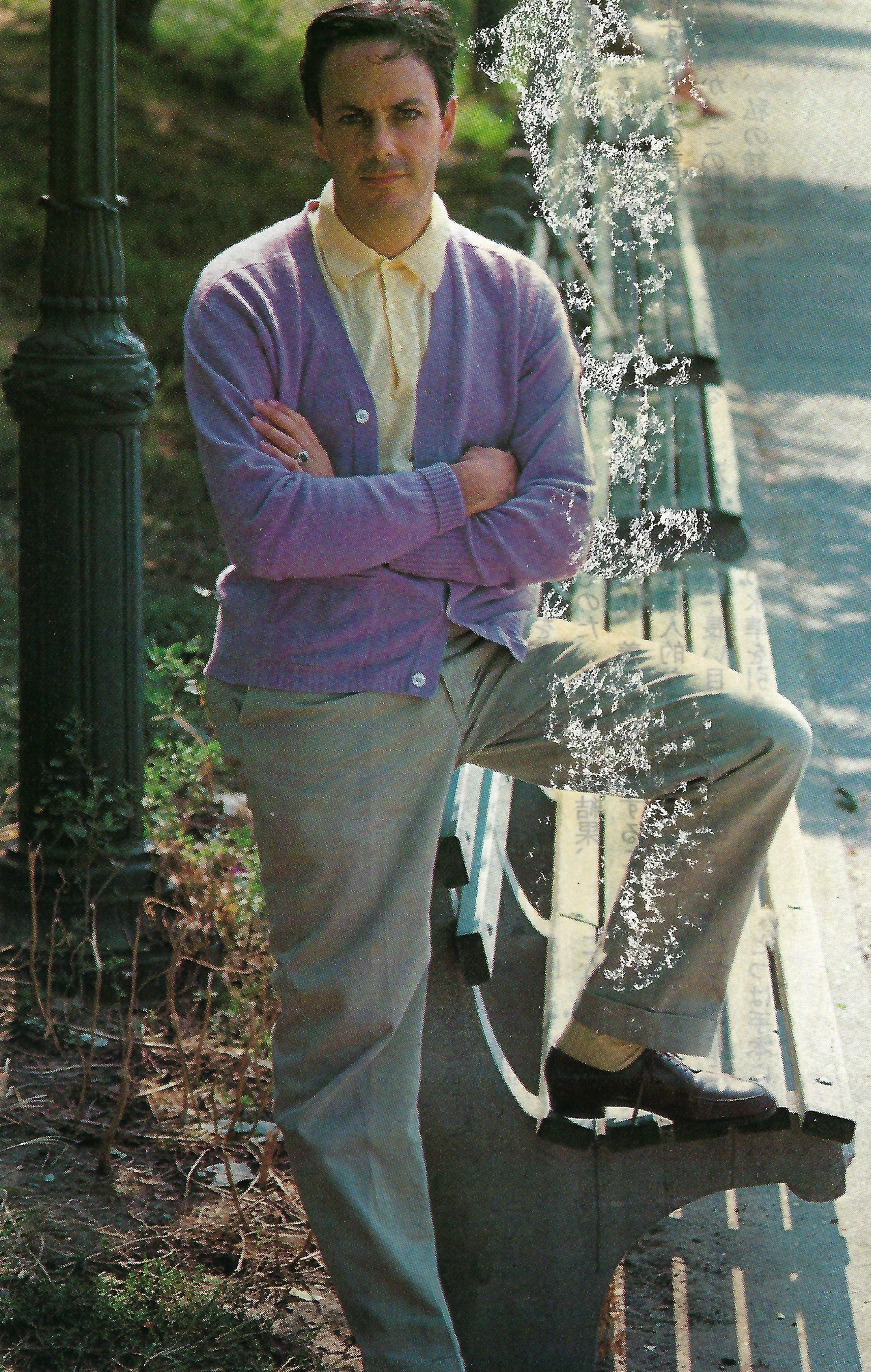 Astairity: A lavender cashmere cardigan over a yellow polo and grey tropical wool trousers   .