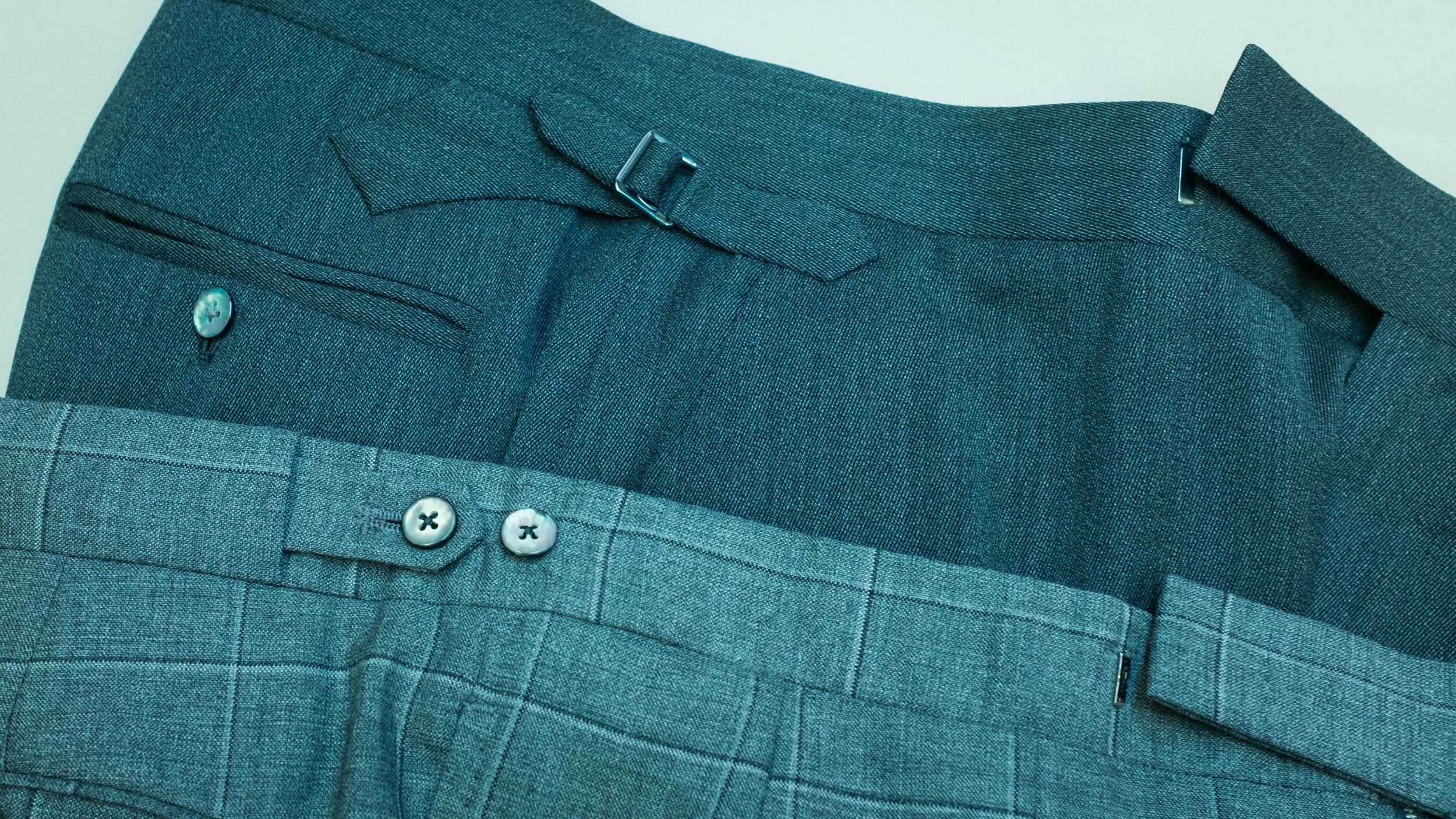 Two classic finishing alternatives to belt loops: the side tab and buckle and DAKS waistband