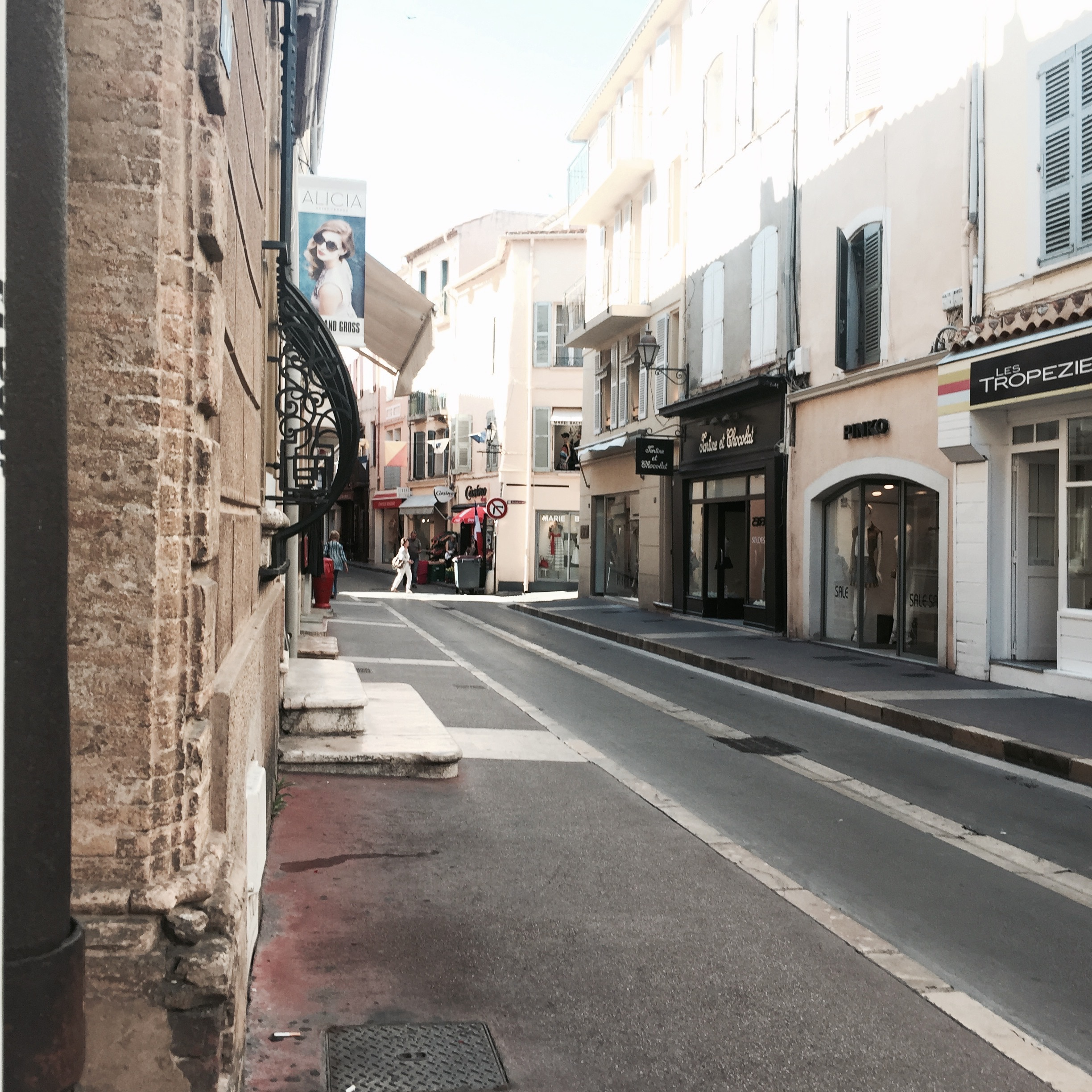 A St. Tropez shopping street in early morning.
