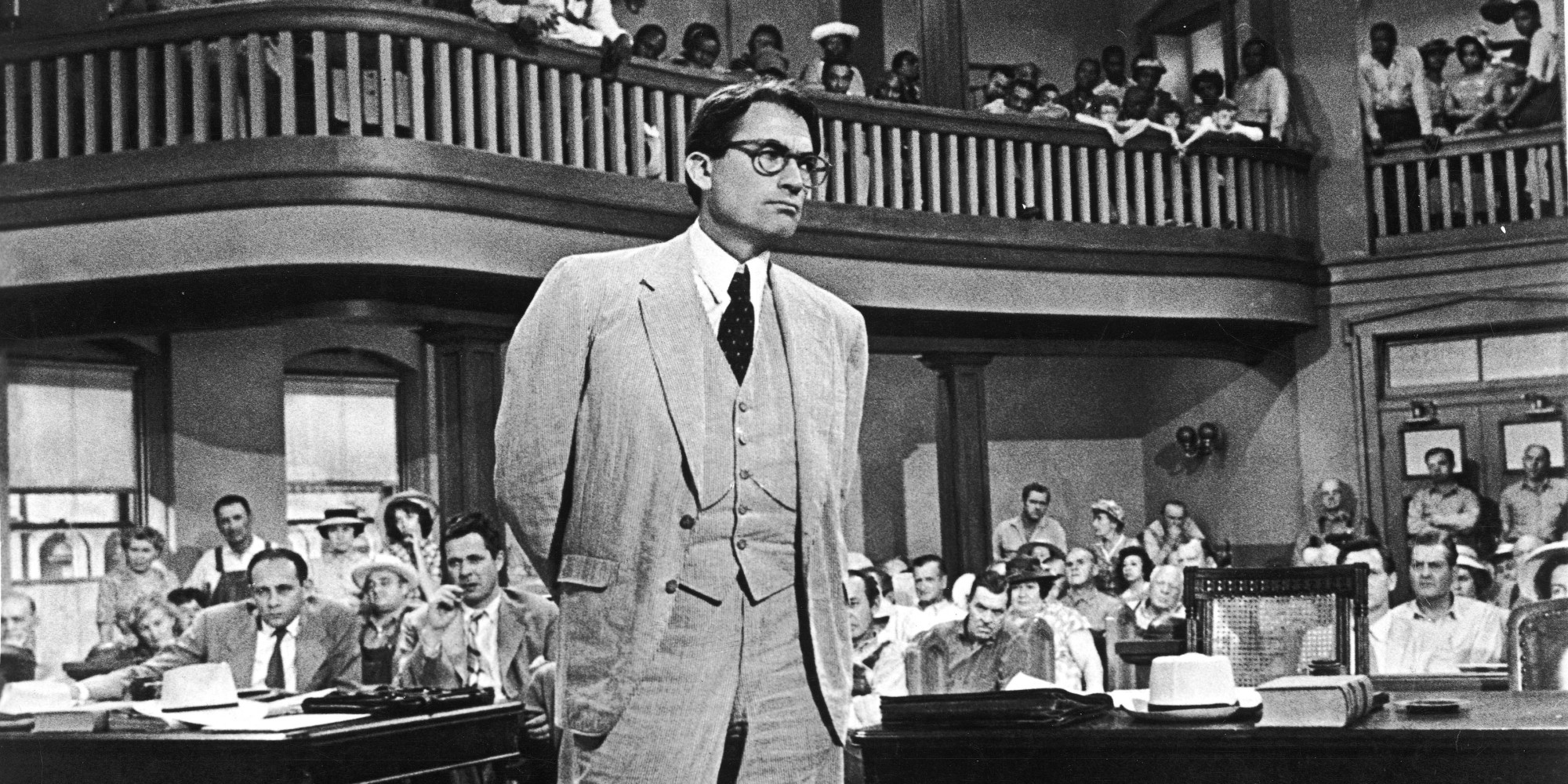 Gregory Peck's redoubtable Atticus Finch commands the courtroom, setting the bar for lawyerly dress.