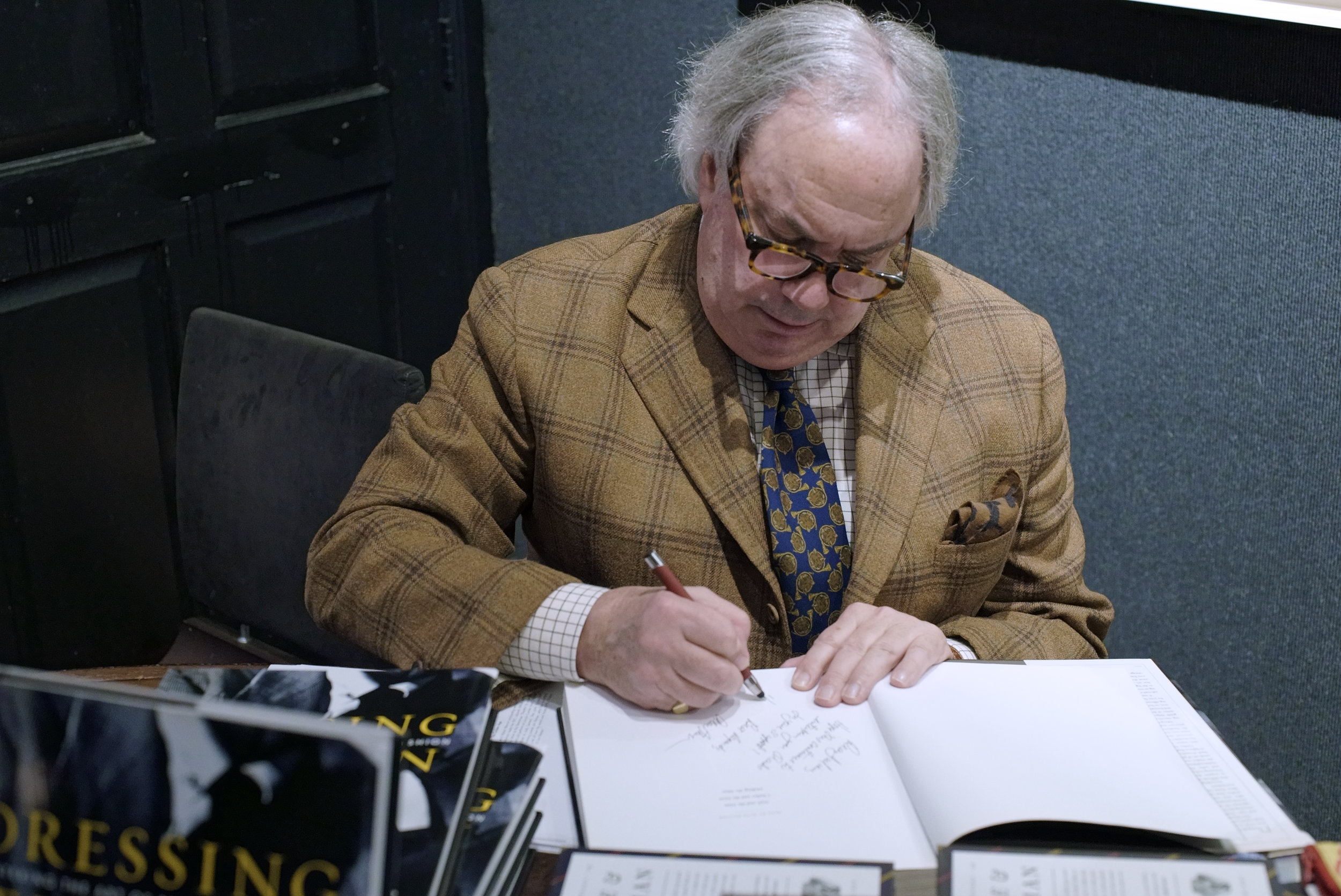 Alan signs copies of  Dressing the Man . Our next appearance at the National Arts Club will be on November 8th, to celebrate the publication of Alan's authorized biography of Ralph Lauren. (Photo by Michael Pushkarskiy)